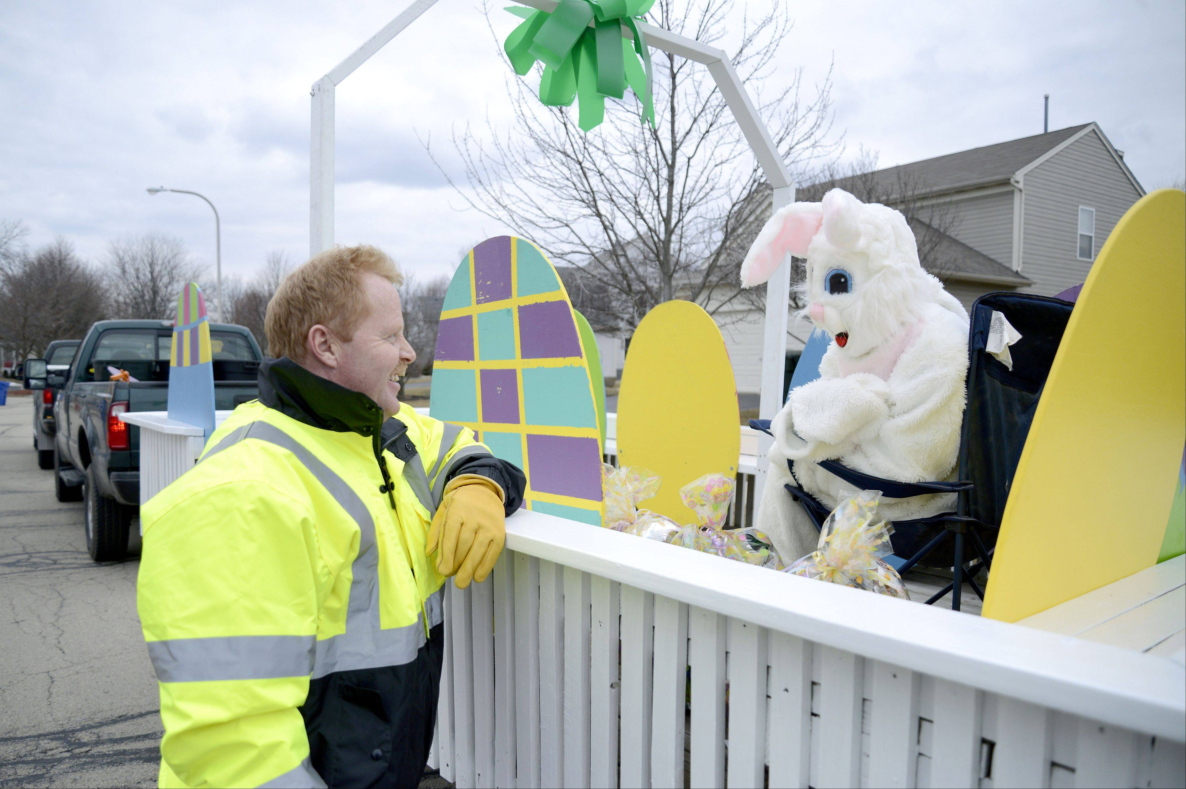 Tyree chats with the Easter Bunny (aka Tessa Eggebrecht of South Elgin) before their next Easter basket delivery. This is Tyree's favorite event his department produces, and he gets a kick out of the children's reactions.
