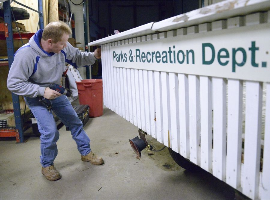 Above, Tyree works on replacing wooden boards on the float to be used for the Easter Bunny basket delivery. Tyree helped build the float from scratch more than 12 years ago, and the department uses it for many events they host. Tyree's job description includes plumbing, electrical and carpentry work, along with equipment upkeep. At left, Tyree even tests out the playground equipment in the winter, when there are fewer kids in the parks.
