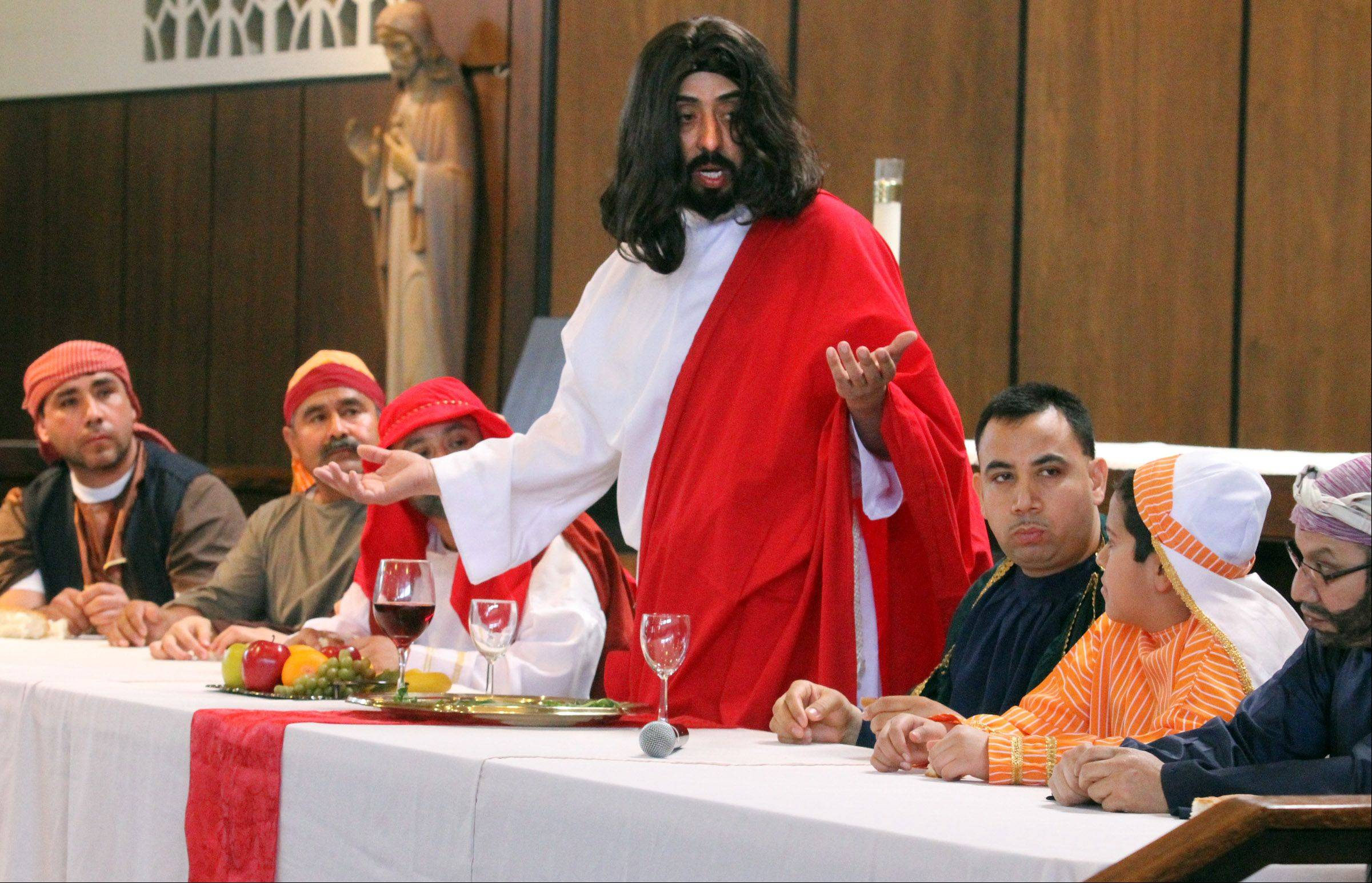 "Jesus played by Miguel Angel Correa of Mundelein speaks to his disciples at last supper during ""Way of the Cross"" at Stanta Maria del Popolo Catholic Church in Mundelein on Friday."
