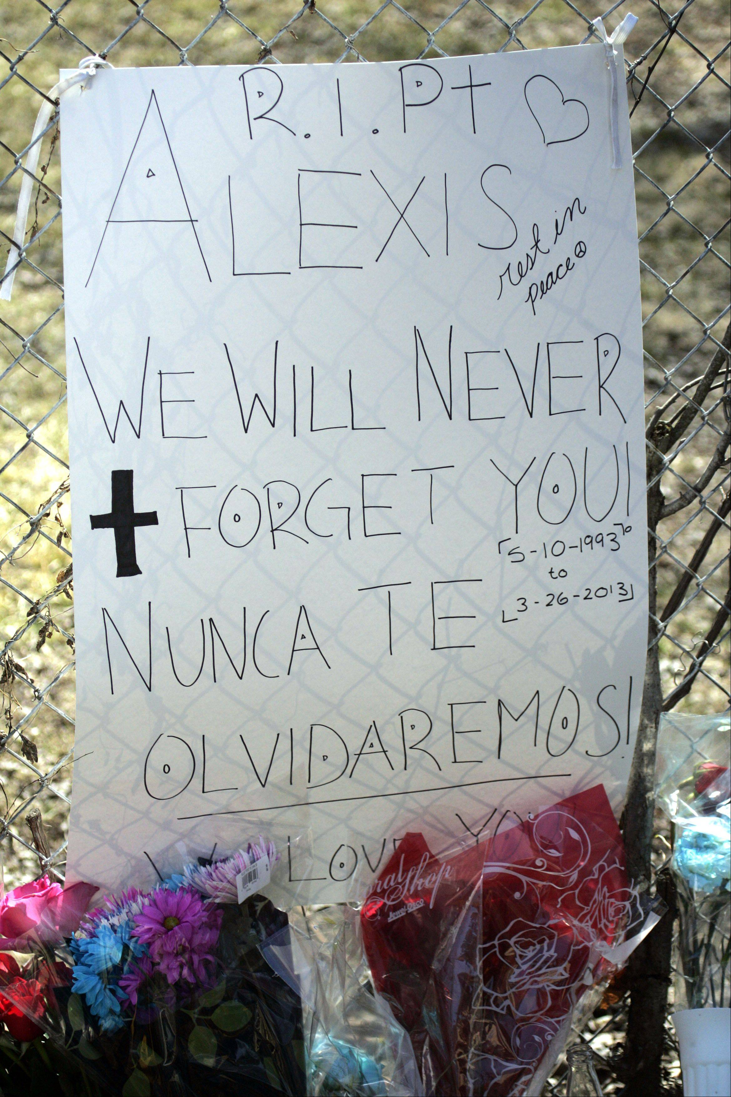 A sign stating that Alexis Huerta will not be forgotten sits at a memorial on the site where 19-year-old was killed in a shooting Tuesday night in Elgin.