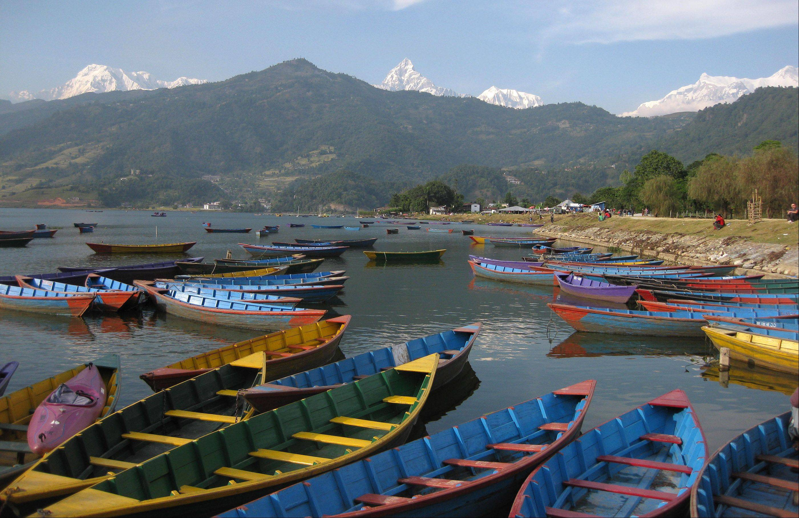 This was taken in November 2012 at Lake Phewa, Pokhara, Nepal with Himalaya Mountains of the Annapurna Sanctuary in the background, following a trek to the Annapurna Base Camp.