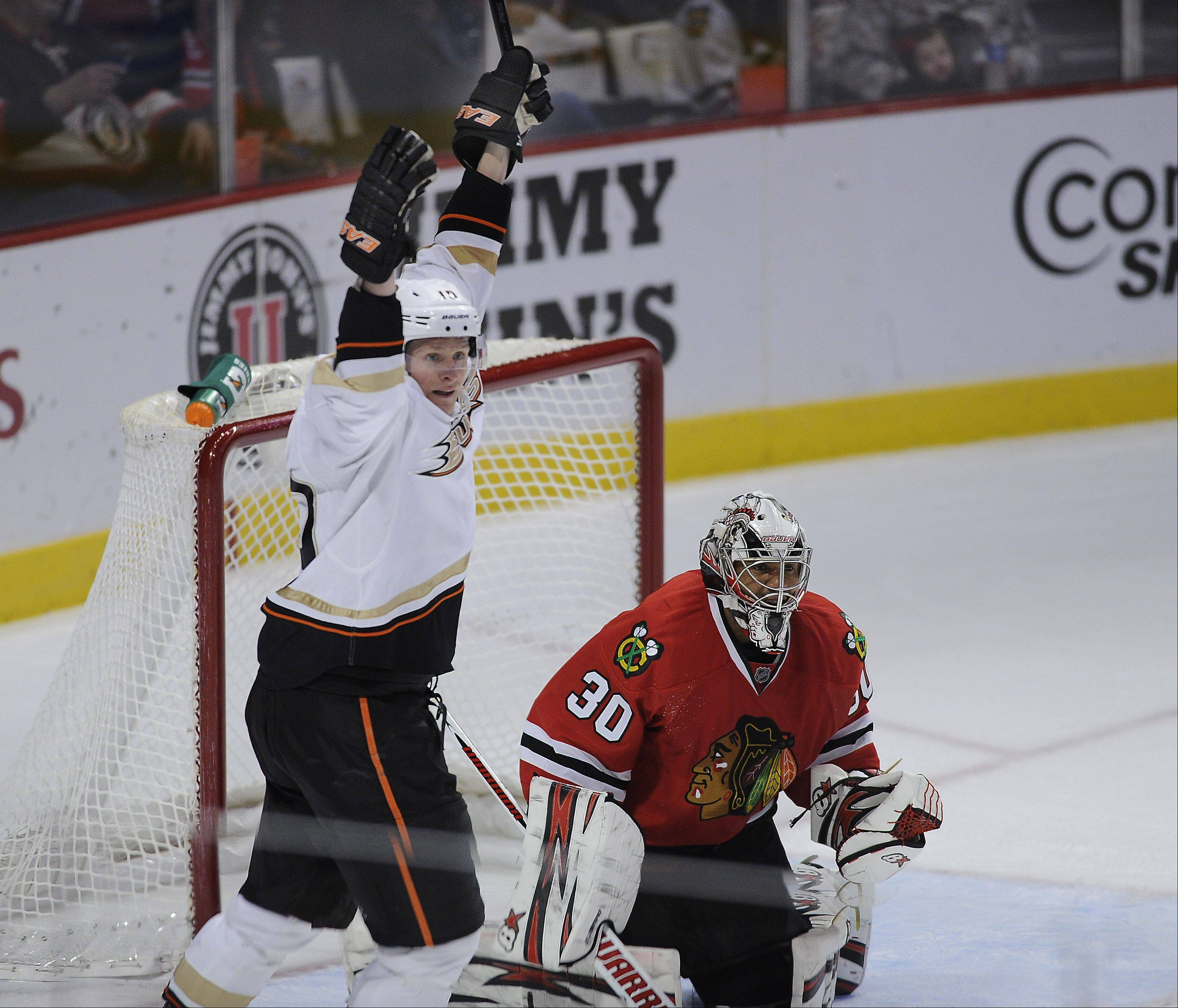 Mark Welsh/mwelsh@dailyherald.comAnaheim's Corey Perry signals goal as Blackhawks goalie Ray Emery can only look on as Anaheim celebrates the go-ahead goal in their victory over the Blackhawks 2-1 at the United Center in Chicago on Friday.