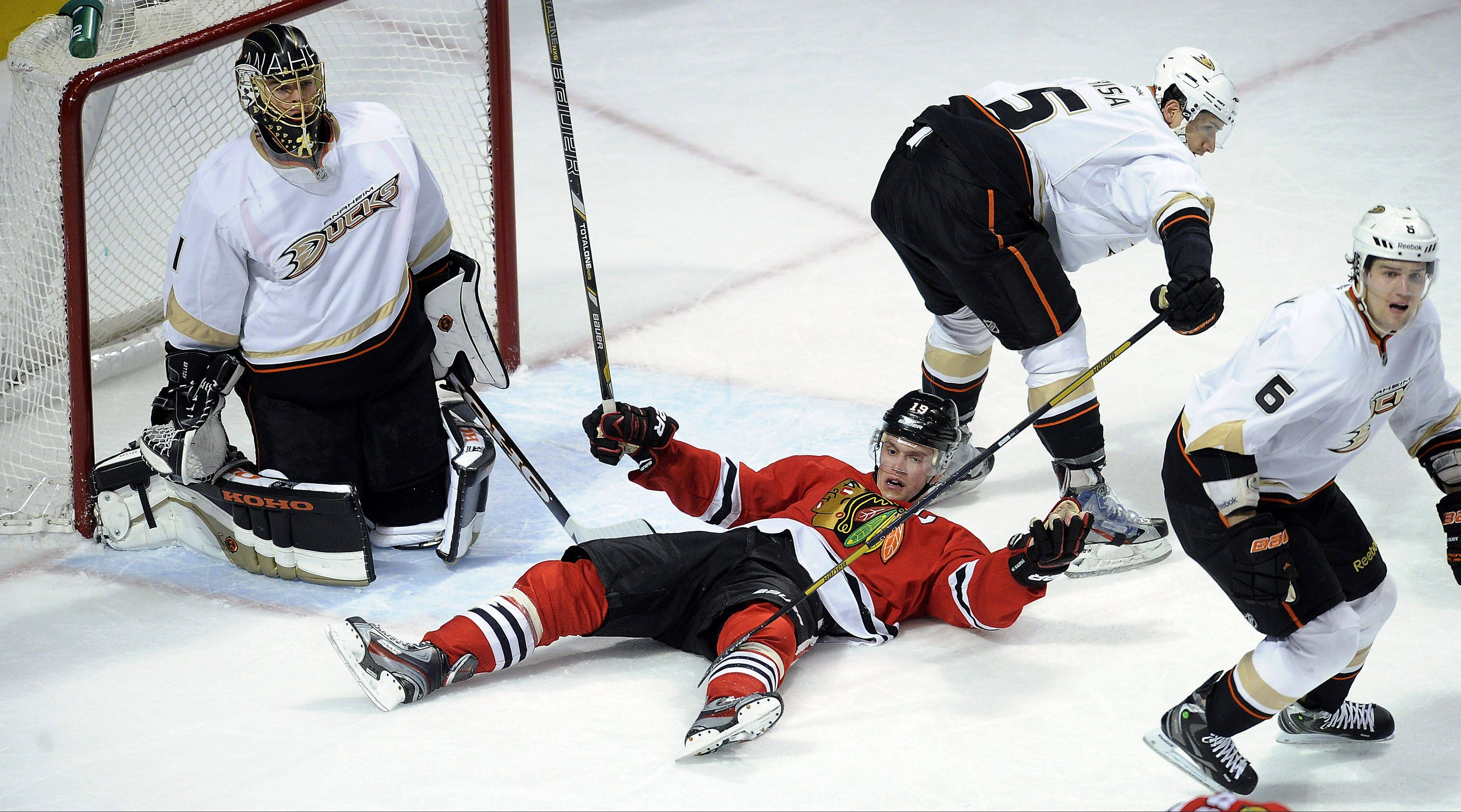 Jonathan Toews goes down under heavy pressure from Anaheim after he tried to score in the first period on Friday.