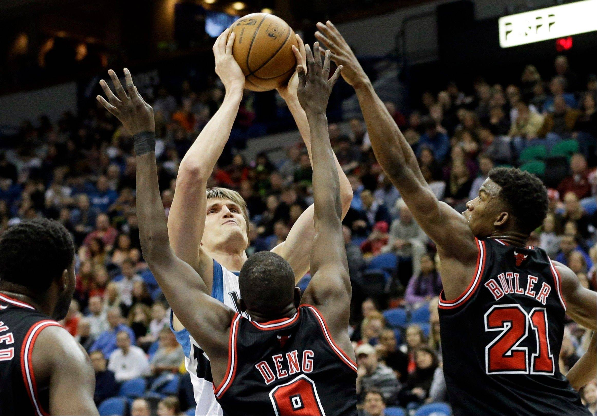 Minnesota's Andrei Kirilenko shoots as Luol Deng (9) and Jimmy Butler (21) defend during their game on March 24. The Bulls are 3-0 this season when when Deng and Butler both start.