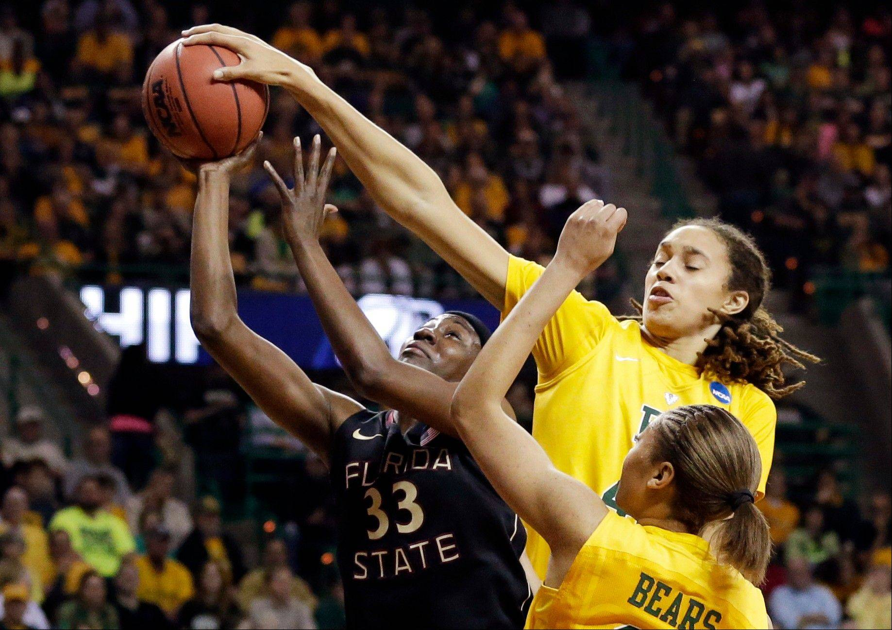 Florida State forward Natasha Howard (33) has her shot blocked by Baylor's Brittney Griner, right rear, as Alexis Prince, bottom, watches in the first half of a second-round game in the women's NCAA college basketball tournament, Tuesday, March 26, 2013, in Waco, Texas.