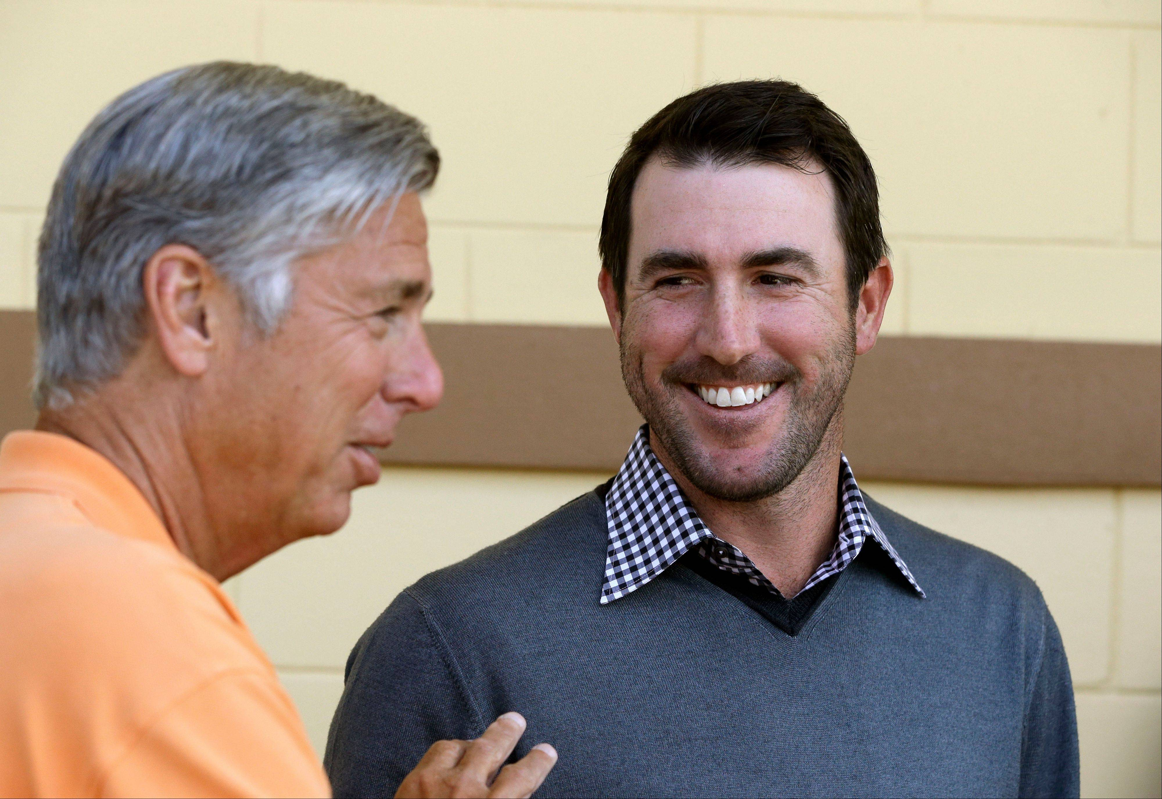 Detroit Tigers pitcher Justin Verlander, right, looks at team president, CEO and general manager Dave Dombrowski during a news conference after a spring baseball exhibition game on Friday, March 29, 2013, in Lakeland, Fla., where Verlander talked about his new seven-year, $180-million contract.