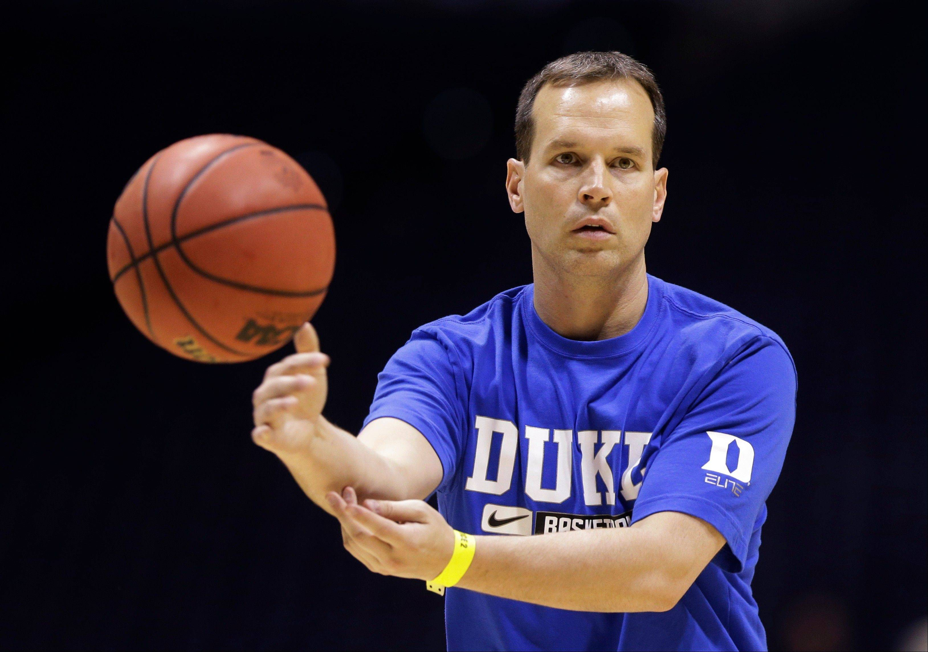 Duke associate head coach Chris Collins directs the team during practice for a regional semifinal game in the NCAA basketball tournament Thursday in Indianapolis. Duke plays Michigan State on Friday. On Tuesday, Collins was hired as the new head coach at Northwestern.