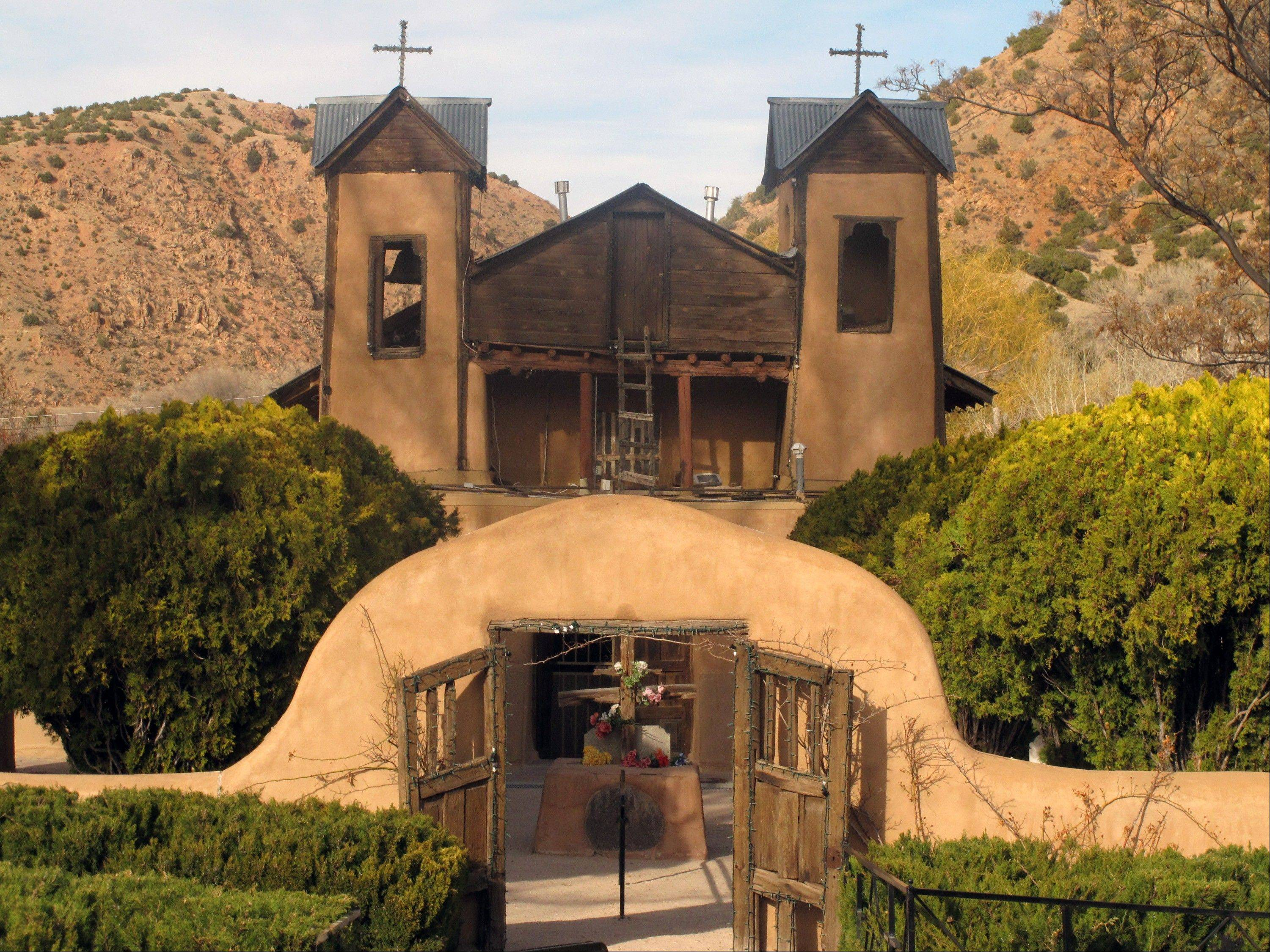 El Santuario de Chimayo in Chimayo, N.M. is shown as volunteers prepare for Easter weekend. Around 50,000 pilgrims are expected to visit the shrine known as the �Lourdes of America.�
