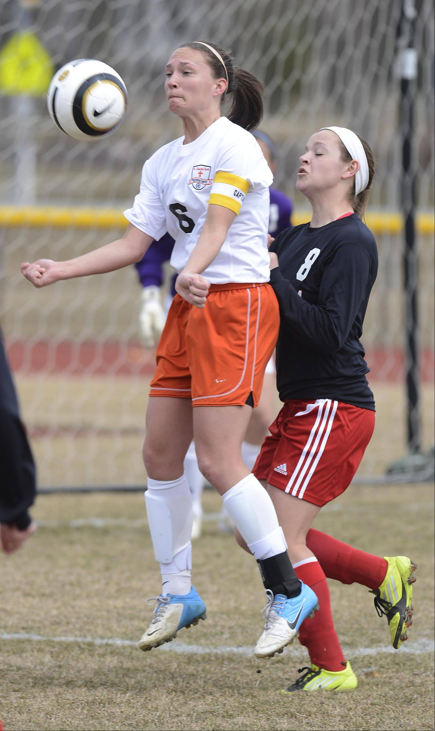 St. Charles East�s Carly Pottle, left, tries to control the ball in front of Batavia defender Brittny Wahlen during Saturday�s game.