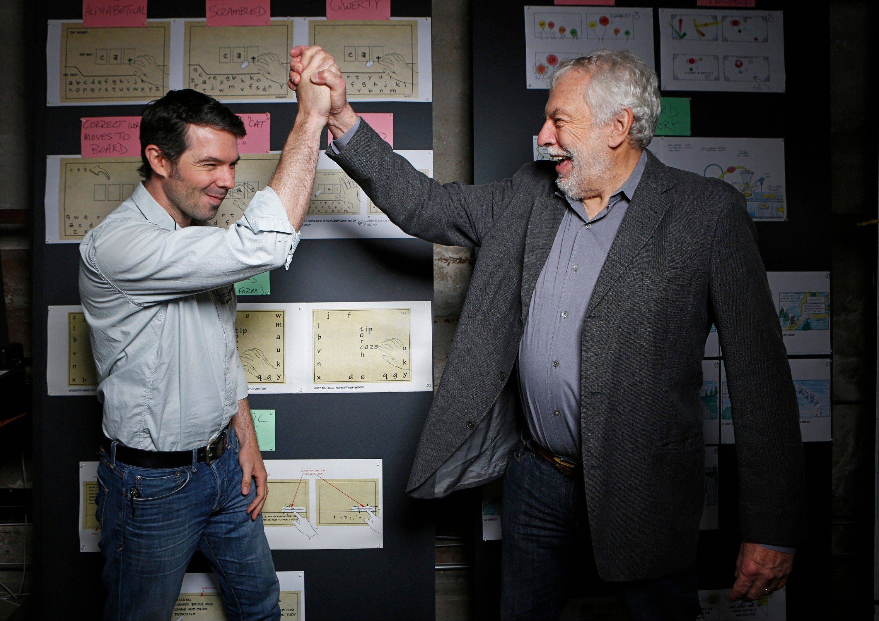 "In this photo taken Wednesday, Mar. 20, 2013, Nolan Bushnell, the founder of Atari, right cheers his son, Brent Bushnell, CEO of ""Two-Bits-Circus,"" a Los Angeles idea factory focused on software, hardware and machines. Nolan Bushnell was the first guy to give Steve Jobs his first full-time job in Silicon Valley at Atari. Two Bit Circus is a unique hybrid of intellectuals, creatives and performers."