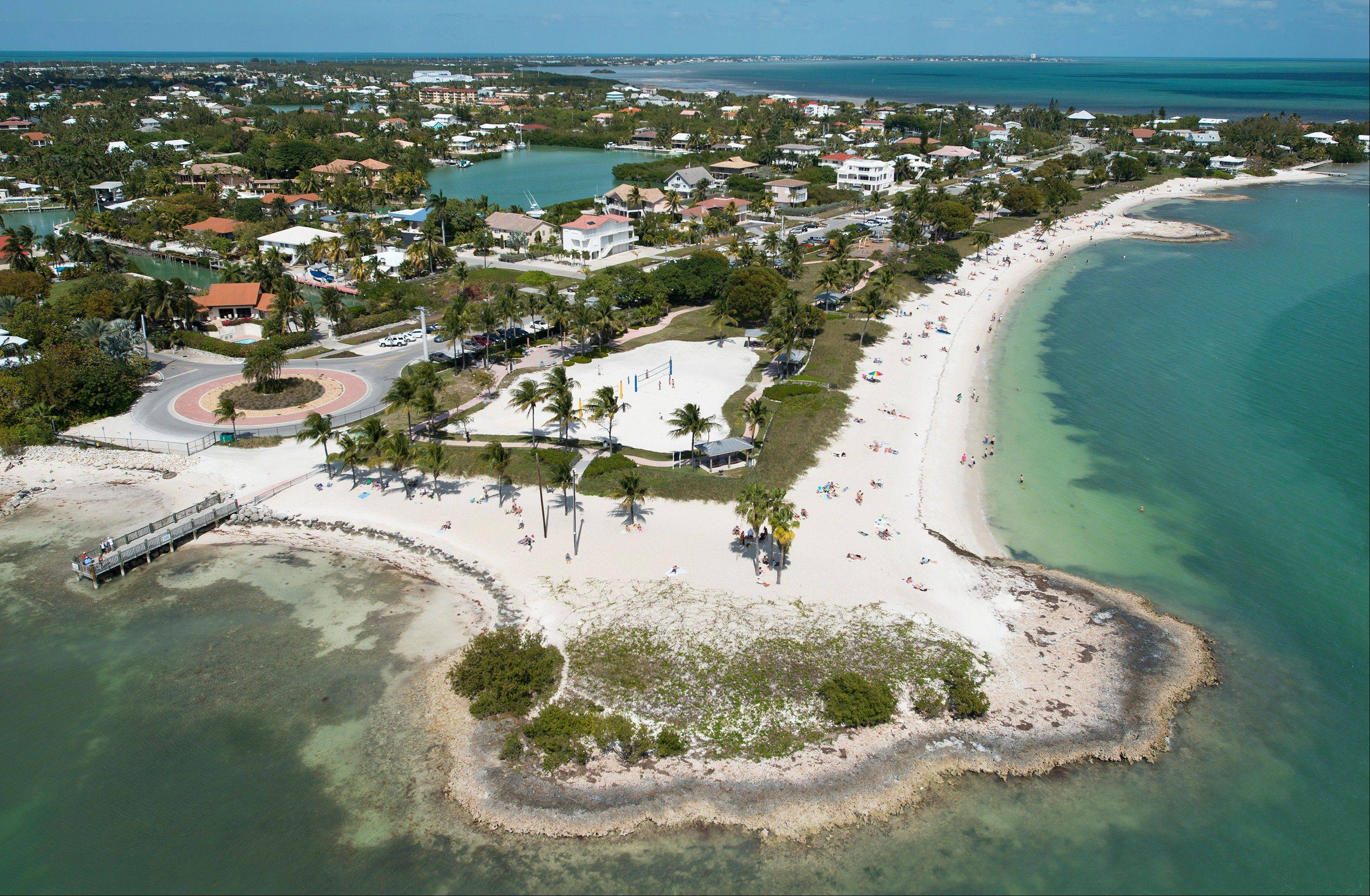 Florida Keys residents and visitors enjoy Sombrero Beach Park in Marathon, Fla. The free-admission park includes volleyball courts, picnic pavilions, playground equipment, restrooms and showers.