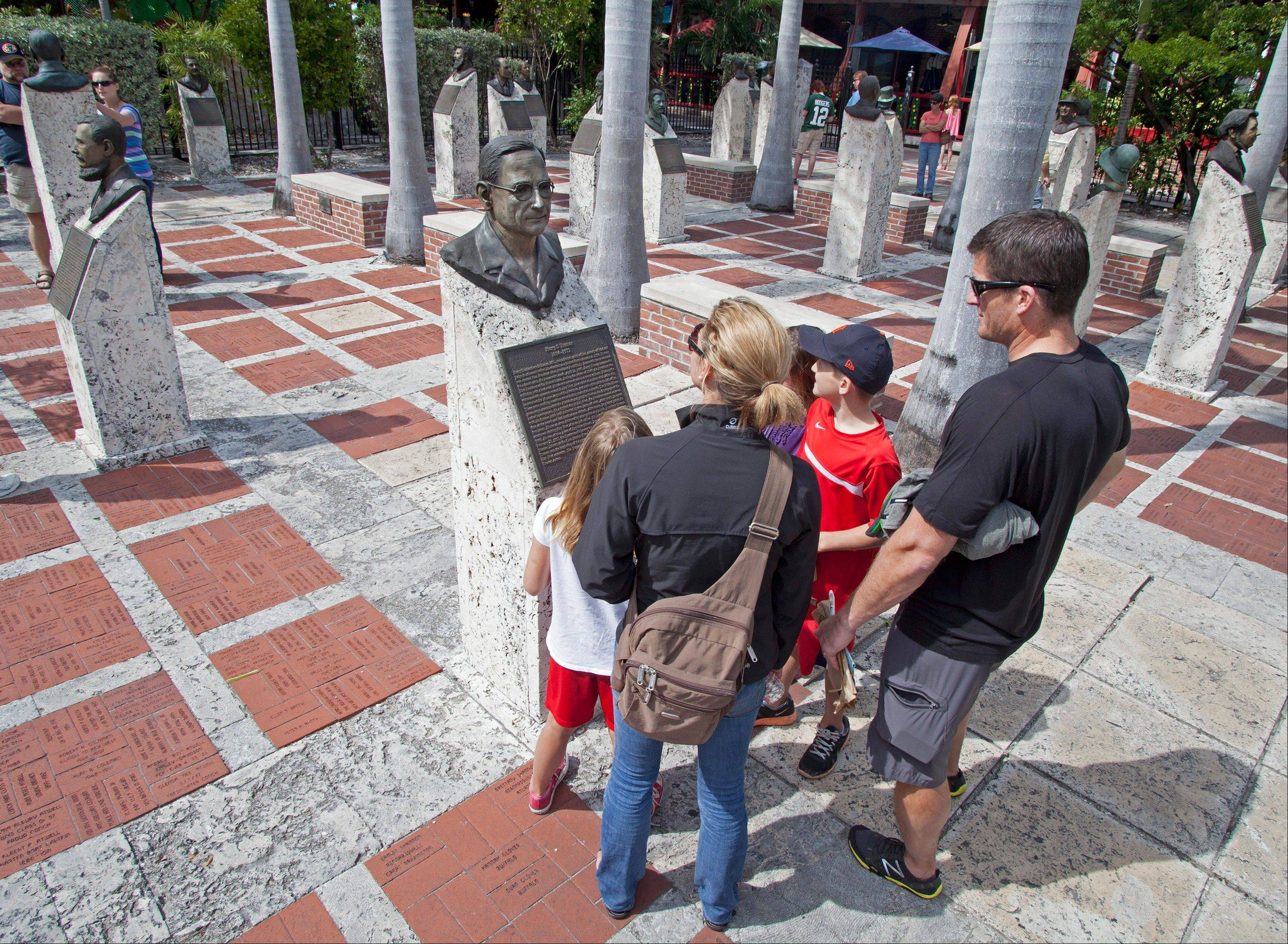 Kate and Matt Hover, and their three children examine a bronze bust of former President Harry S. Truman in the Key West Historic Memorial Sculpture Garden.