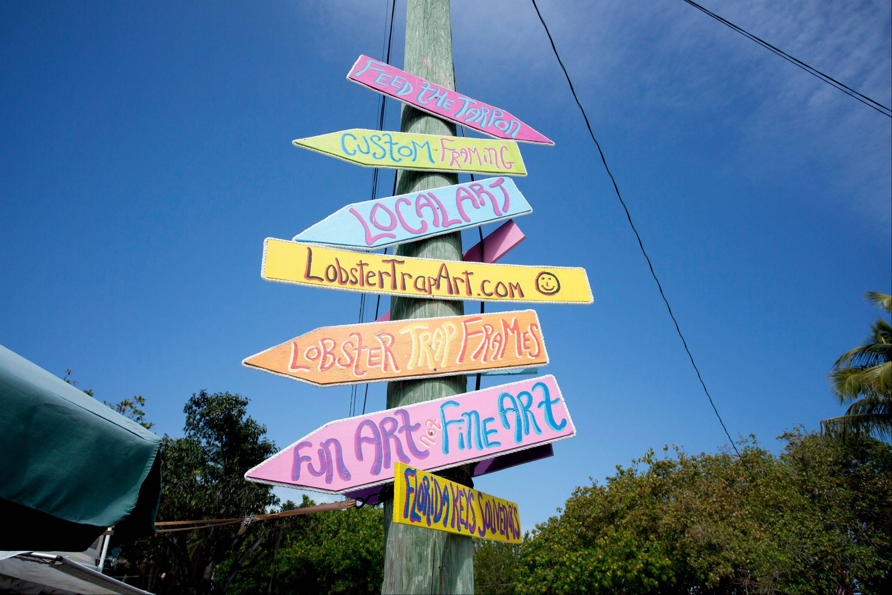 Signs for art galleries are shown in Lower Matecumbe Key, Fla.