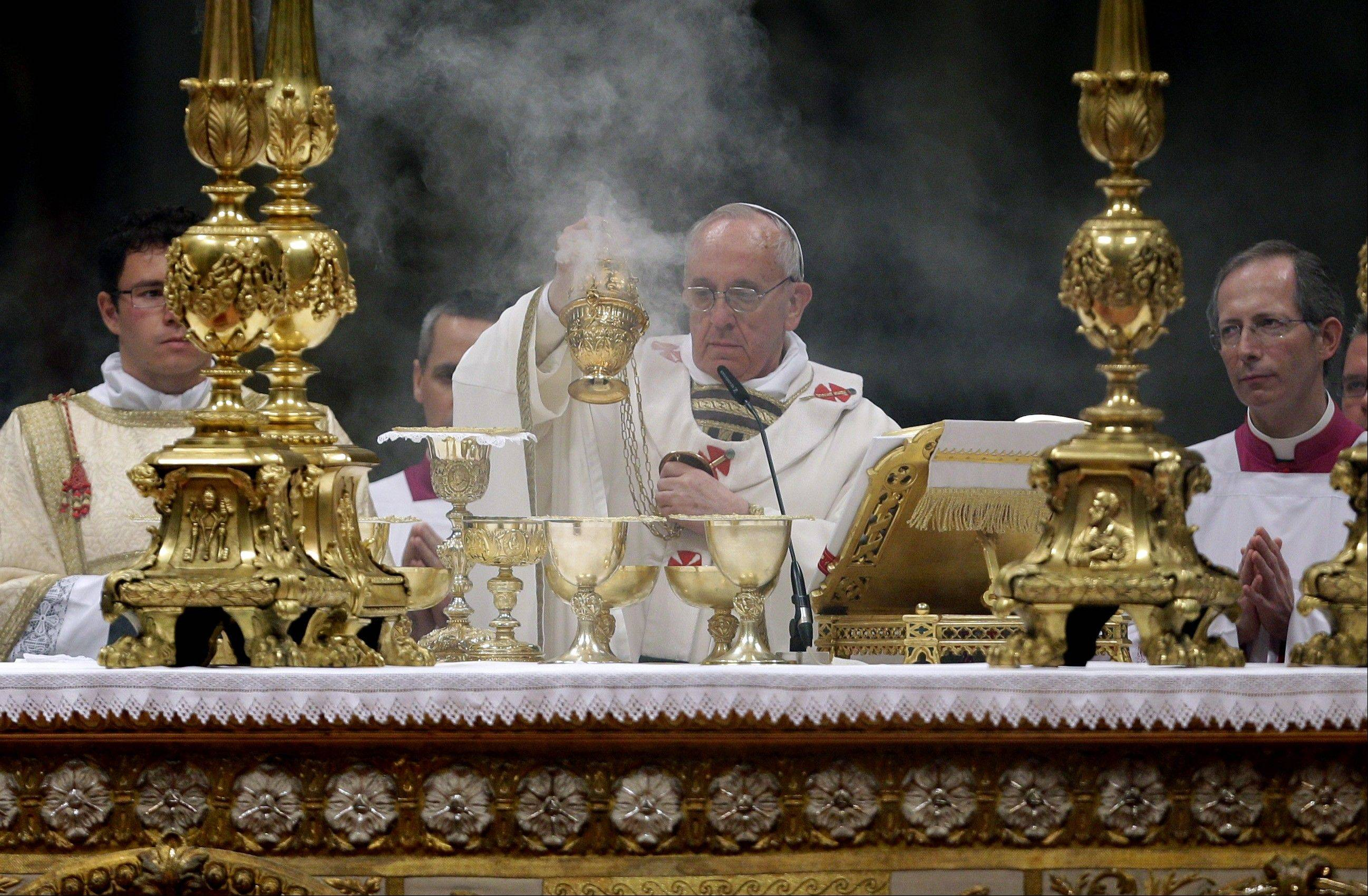 Pope Francis leads the Easter vigil service Saturday in St. Peter's Basilica, at the Vatican.