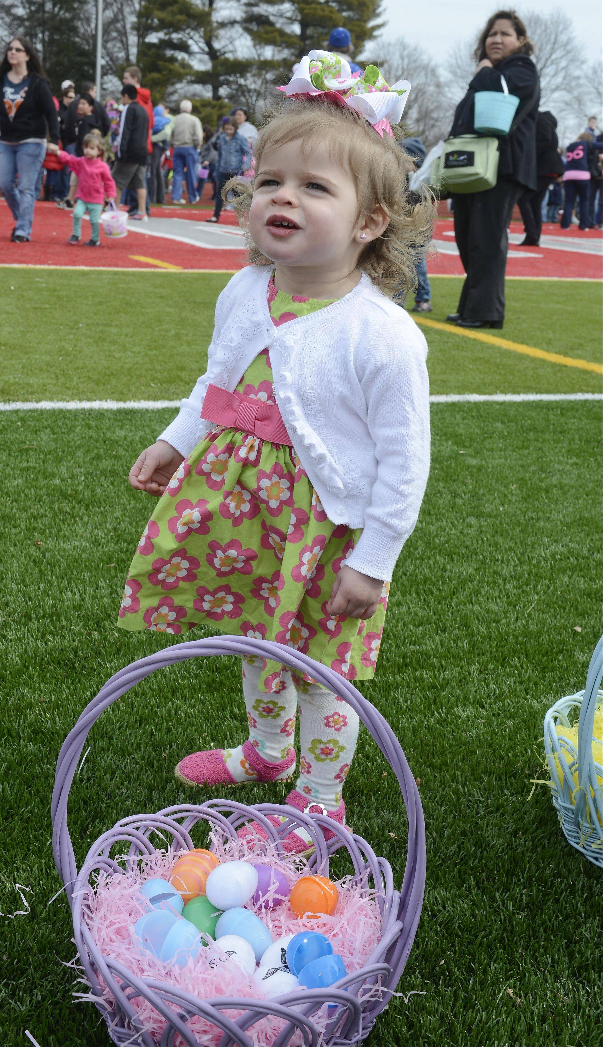 Gabriella Allen, age 20 months of West Chicago, has a basket of eggs during Saturday's Easter egg hunt at Mooseheart.