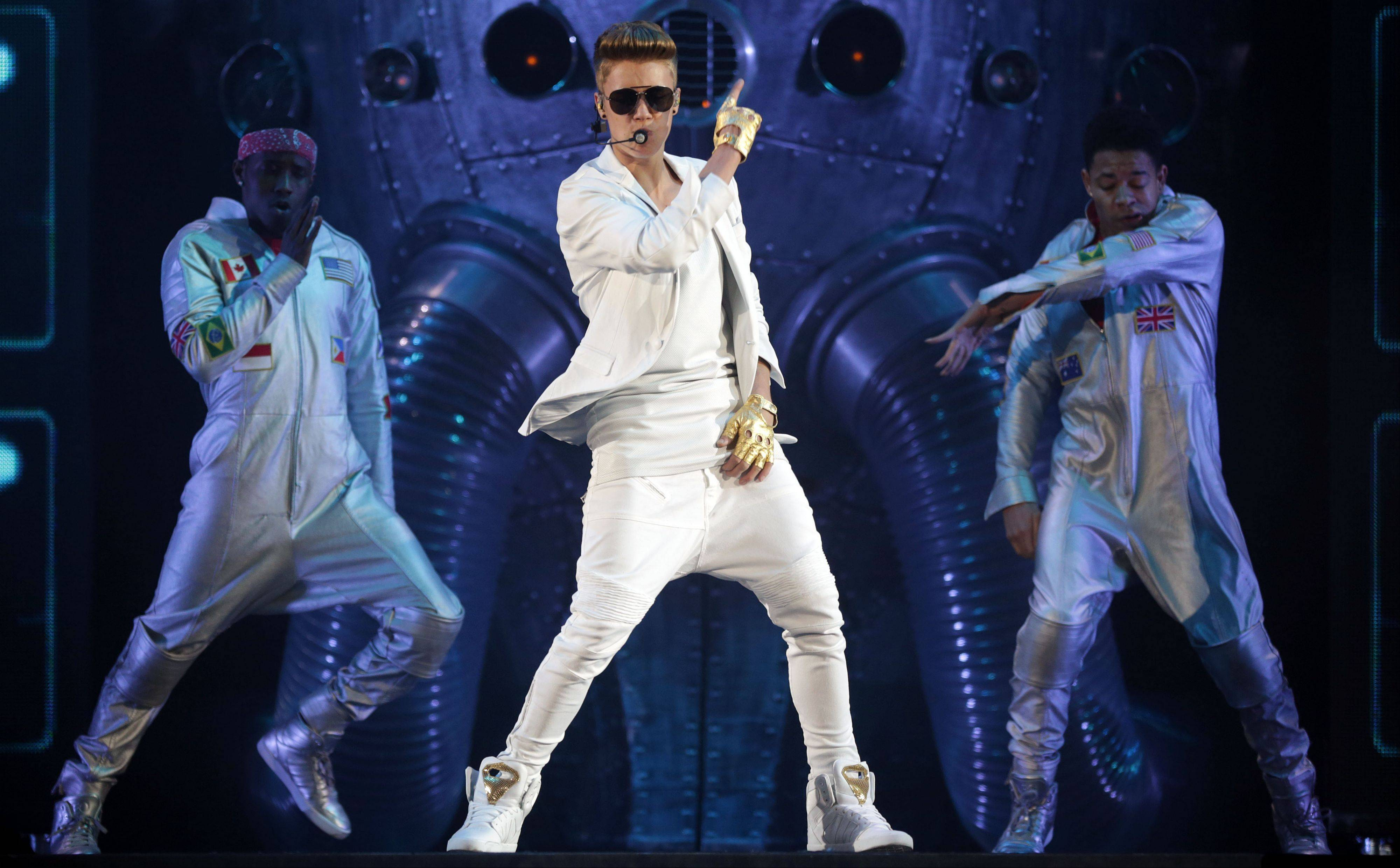 "Canadian singer Justin Bieber performs on stage during the ""I Believe Tour "" in Munich. A German official says Bieber had to leave a monkey in quarantine after arriving in the country last week without the necessary papers for the animal."