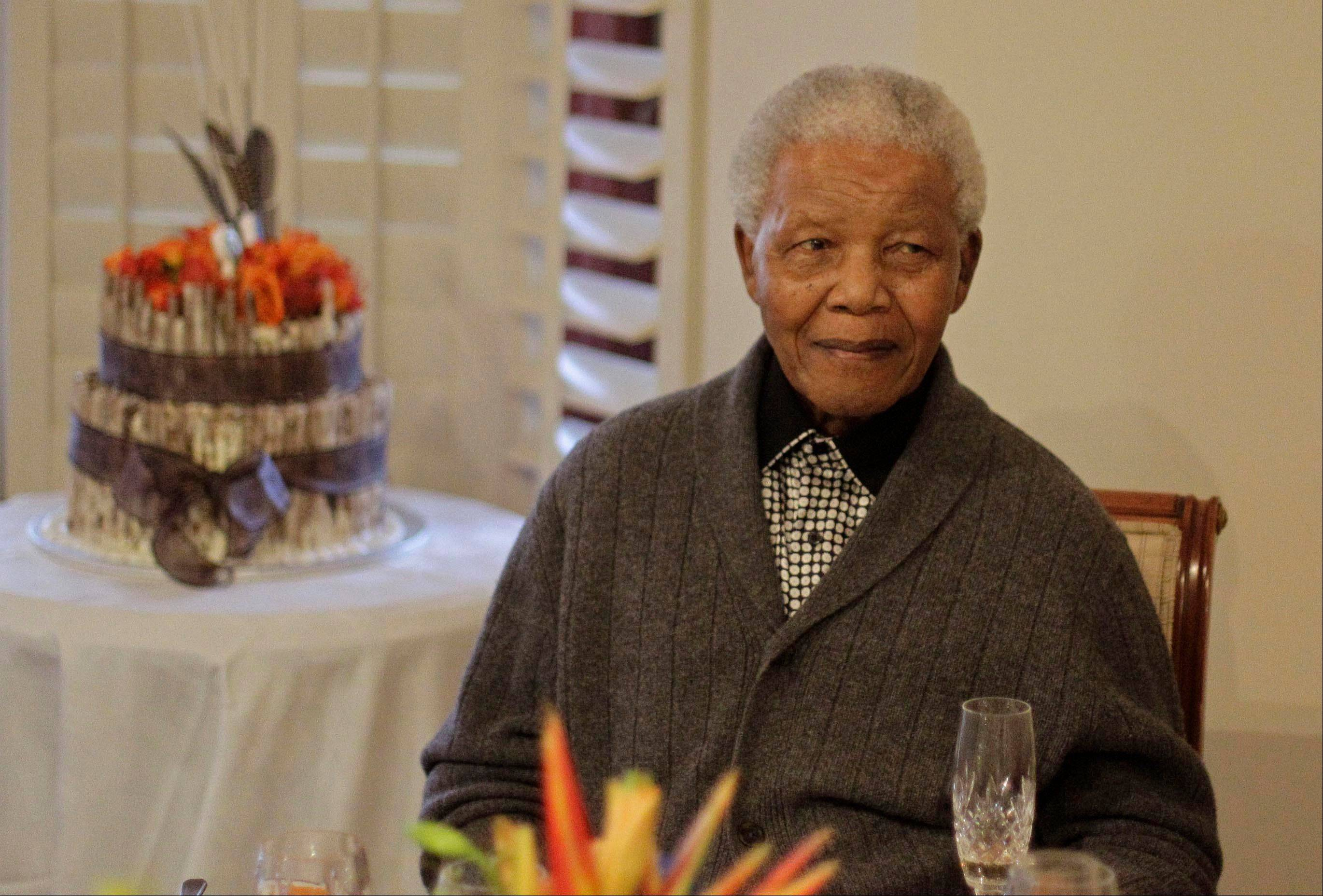 "In this file photo, former South African President Nelson Mandela celebrated his 94th birthday in July in Qunu, South Africa. A South African official says Mandela is breathing ""without difficulty"" after having a procedure to clear fluid in his lung area that was caused by pneumonia."