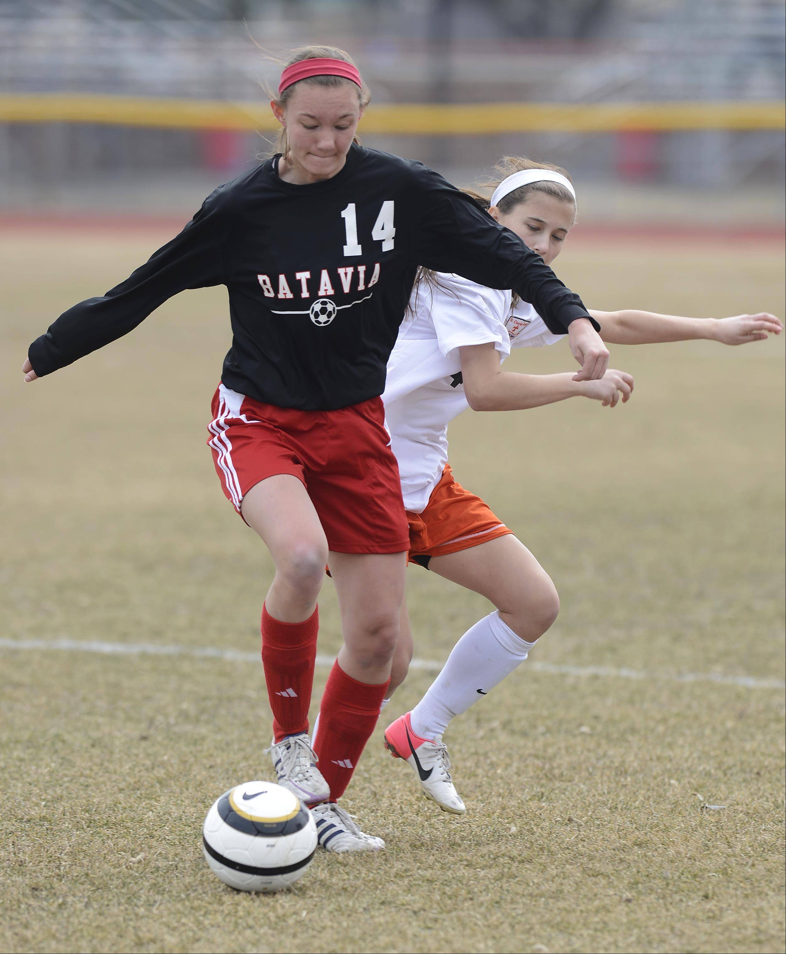 Batavia's Kayla Stolfa, left, tries to fend off St. Charles East's Ally Potterton during Saturday's game.