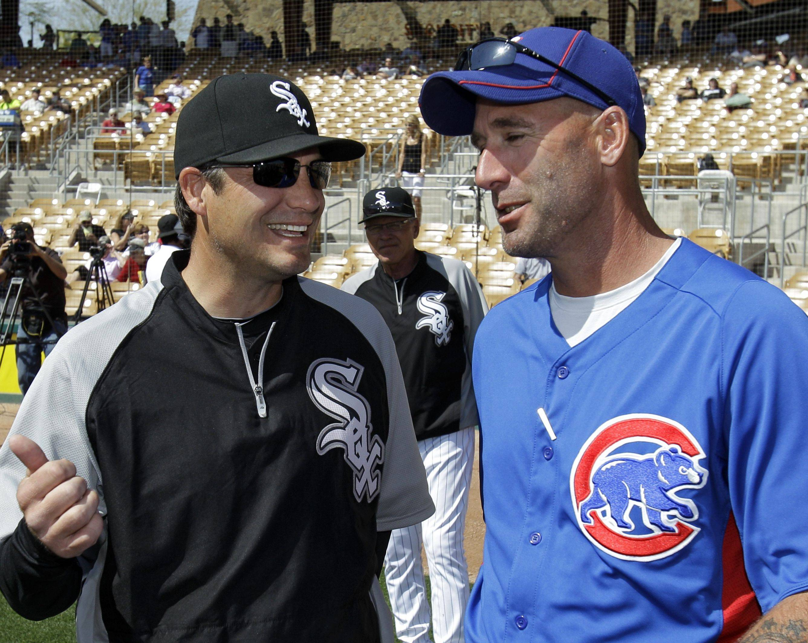 Robin Ventura, left, and the White Sox have a chance to compete this year in the AL Central if Alex Rios, Adam Dunn and Paul Konerko can put together big seasons. As for Dale Sveum's Cubs? If all goes right, the North Siders should have a shot at the postseason by 2015.