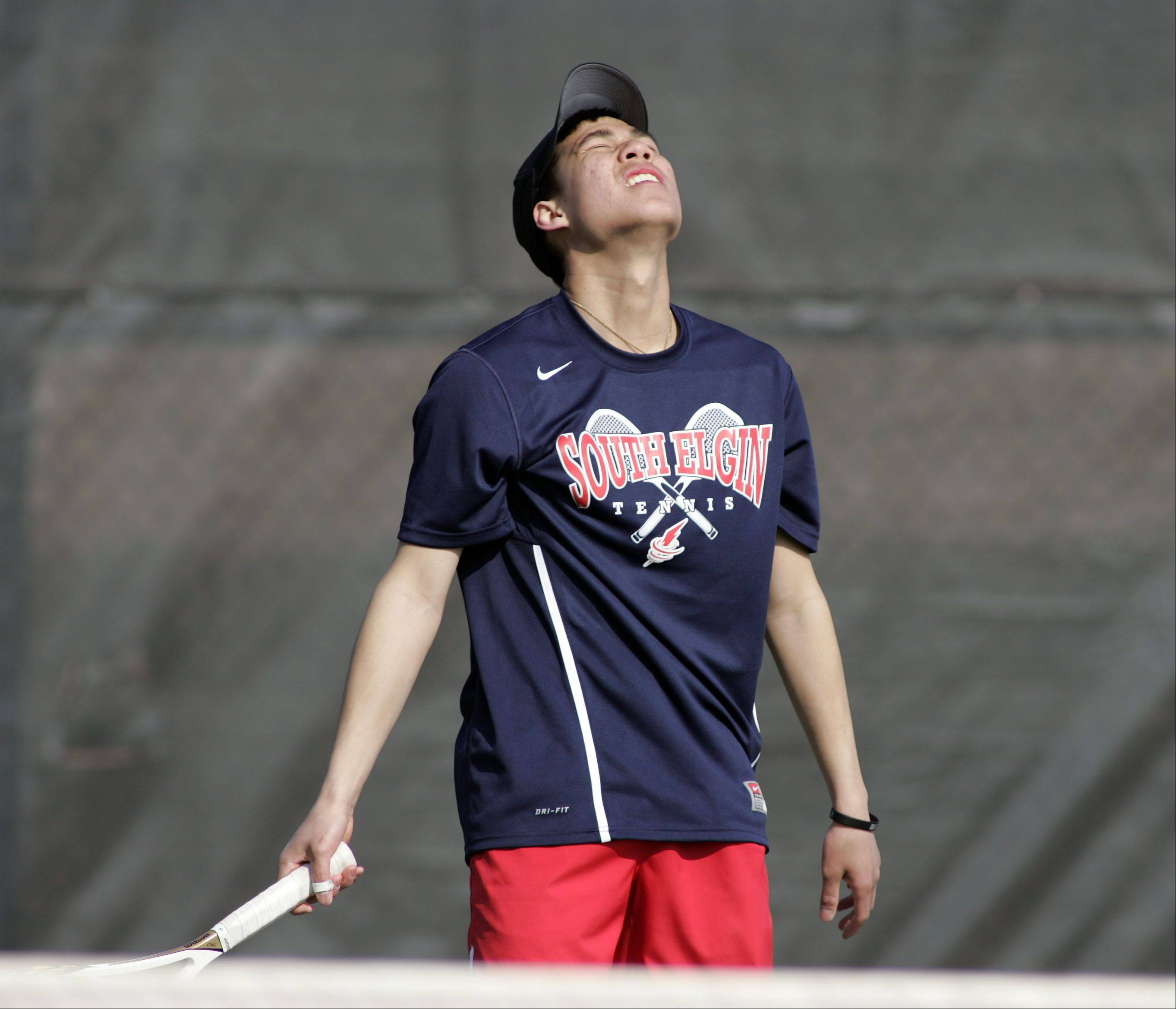 South Elgin's Andre Norasith, reacts after a missed shot during the Cary-Grove boys tennis invite Saturday in Cary.