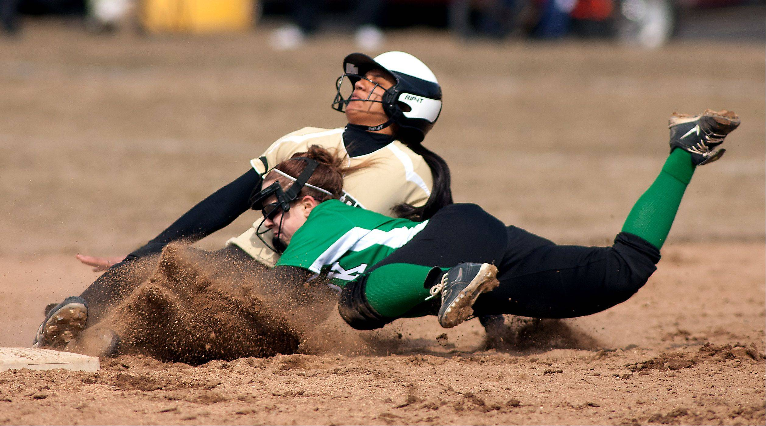 Glenbard North's Rucha Amin is tagged out by York's Audrey Kosman during girls softball action.