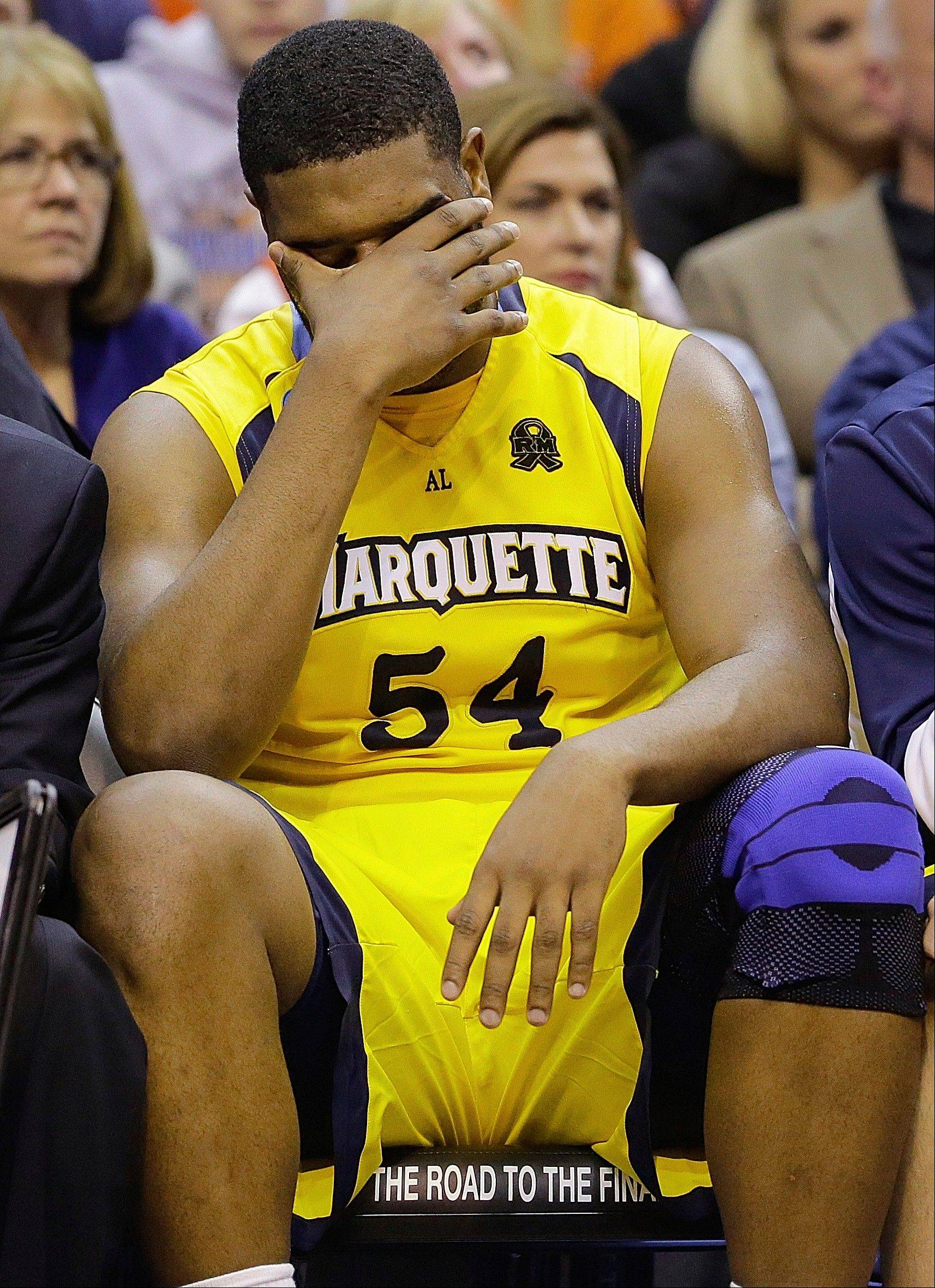 Marquette forward Davante Gardner (54) sits on the bench during the second half of the East Regional final in the NCAA men's college basketball tournament against Syracuse, Saturday, March 30, 2013, in Washington. Syracuse won 55-39.