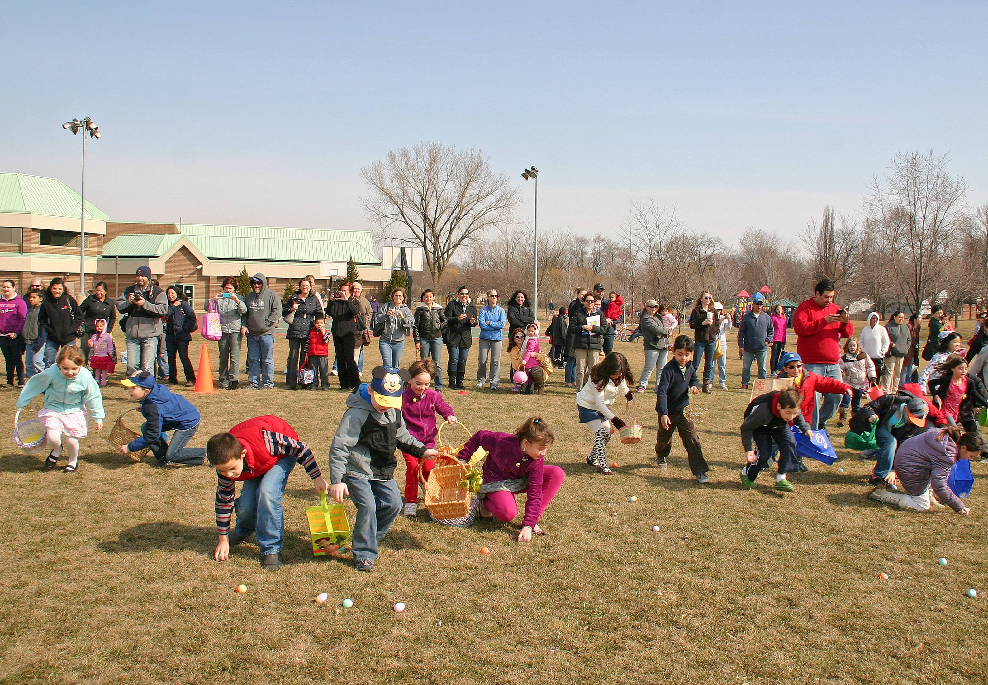 Children ages 4-6 hunt for treat and toy filled eggs at the annual Des 			Plaines Park District free Easter Egg Hunt on March 30 at Prairie Lakes Park.