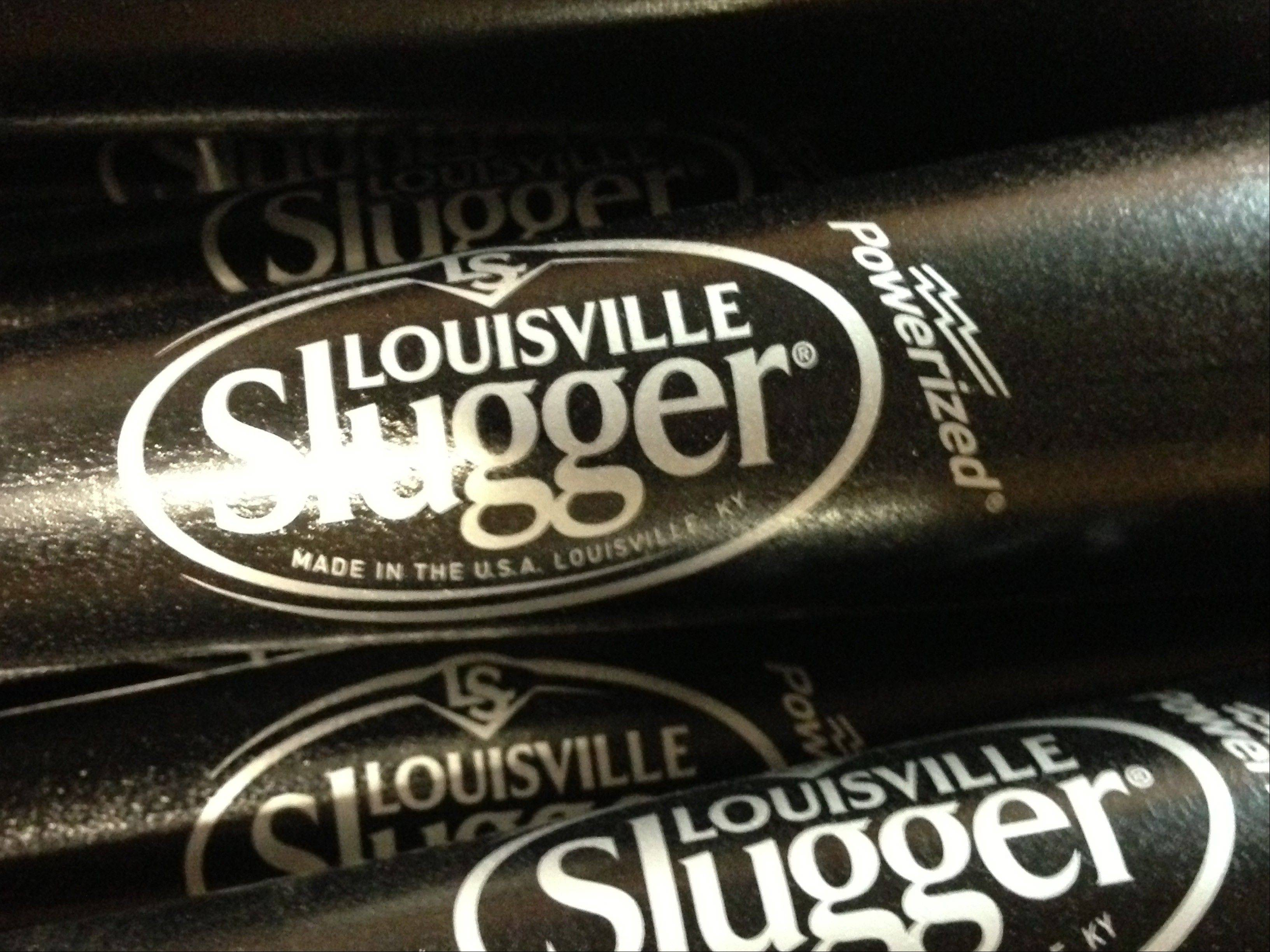 Louisville Slugger is rolling out a new logo for the first time in 33 years on a new bat that company officials say is designed to be the hardest wooden bat ever produced at the Louisville, Ky., factory.