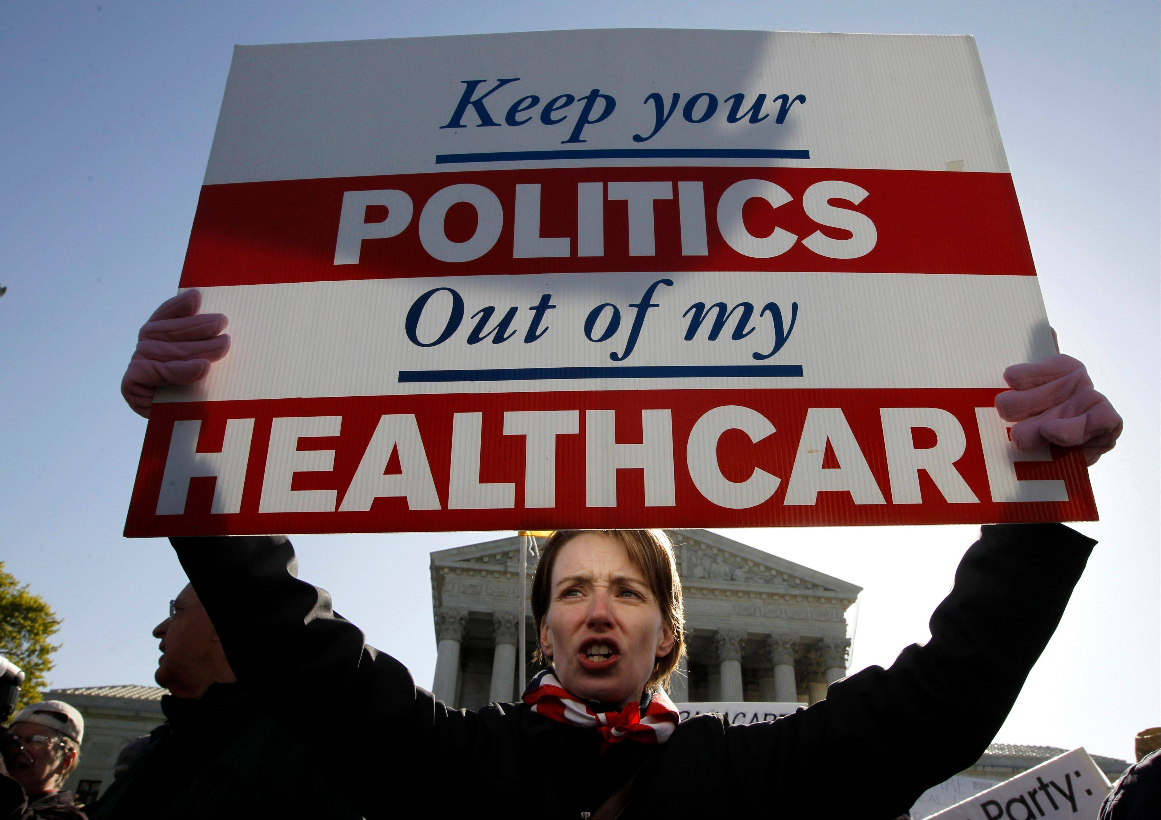 In this March 27, 2012, file photo, Amy Brighton of Medina, Ohio, who opposes health care reform, rallies in front of the Supreme Court in Washington. Health care was the defining political battle of President Barack Obama�s first term, and _ after the economy_ it remains his most complicated policy challenge at home, central to his place in history.