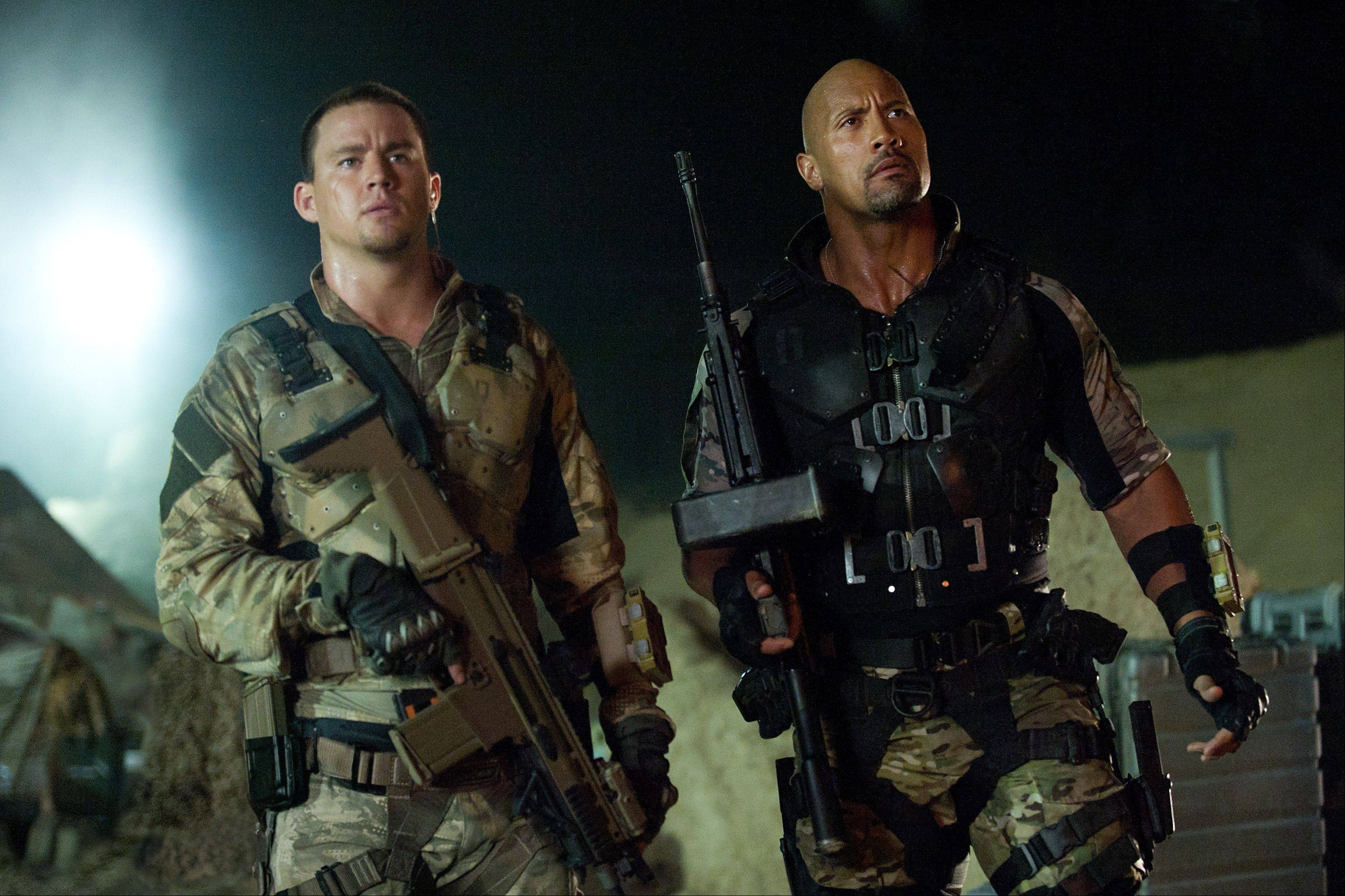 "This film image released by Paramount Pictures shows Channing Tatum, left, and Dwayne Johnson in a scene from ""G.I. Joe: Retaliation,"" which debuted at No. 1 at the box office with a $41 million haul."
