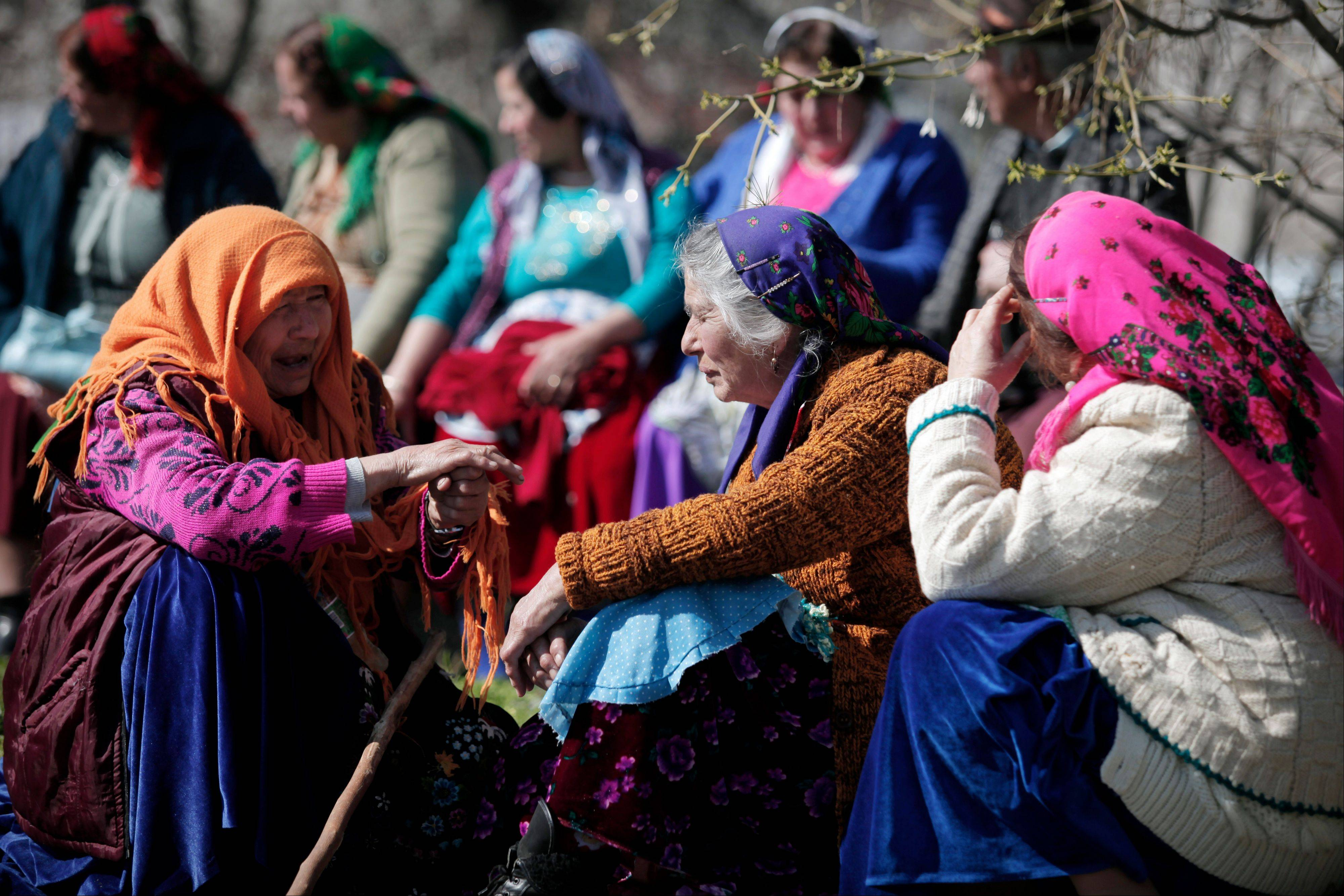 "Elderly Roma women from the Kalaidzhi community having a chat during so called ""Roma bridal market."" The Kalaidzhi, who represent only a small portion of the estimated 700,000 Roma in Bulgaria, are almost all devout Orthodox Christians who keep teenage boys and girls separate."