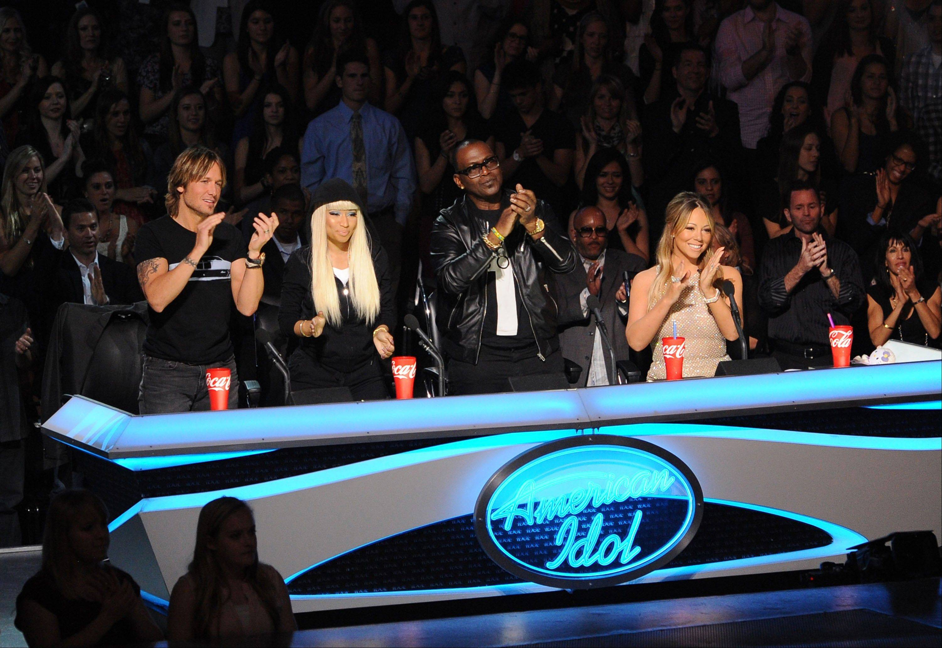 "This undated image released by Fox shows judges, from left, Keith Urban, Nicki Minaj, Randy Jackson and Mariah Carey from the singing competition series, ""American Idol,"" airing Wednesdays and Thursdays on Fox. In its 12th season, ""American Idol"" is managing to hit the right notes with sponsors if not always with fickle viewers. It has retained its status as TV's advertising leader among series and the loyalty of its biggest backers, including Ford and Coca-Cola."