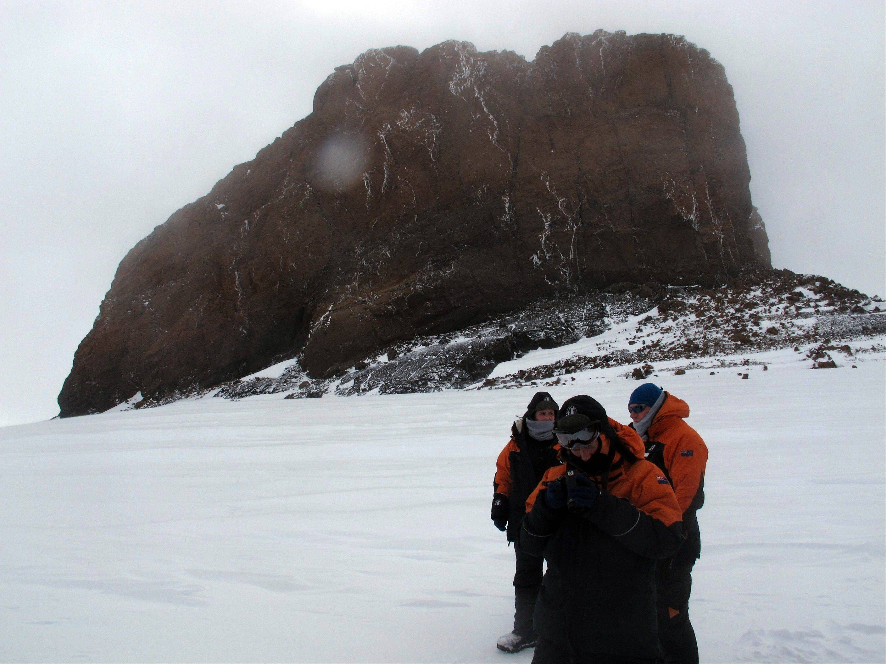 Tourists near Castle Rock on Crater Hill on Ross Island, Antarctica. Tourism is rebounding here five years after the financial crisis stifled what had been a burgeoning industry.