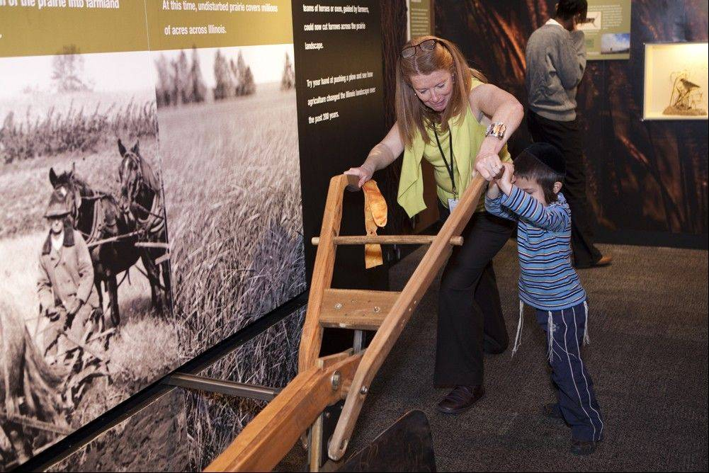 "In the ""Food: The Nature of Eating"" exhibit, visitors can try pushing a plow to see how farm work was done in the 1800s."