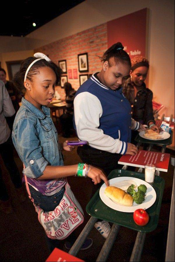 The new exhibit on eating features a lunch line, which shows the difference between processed food and more nutritious meals.