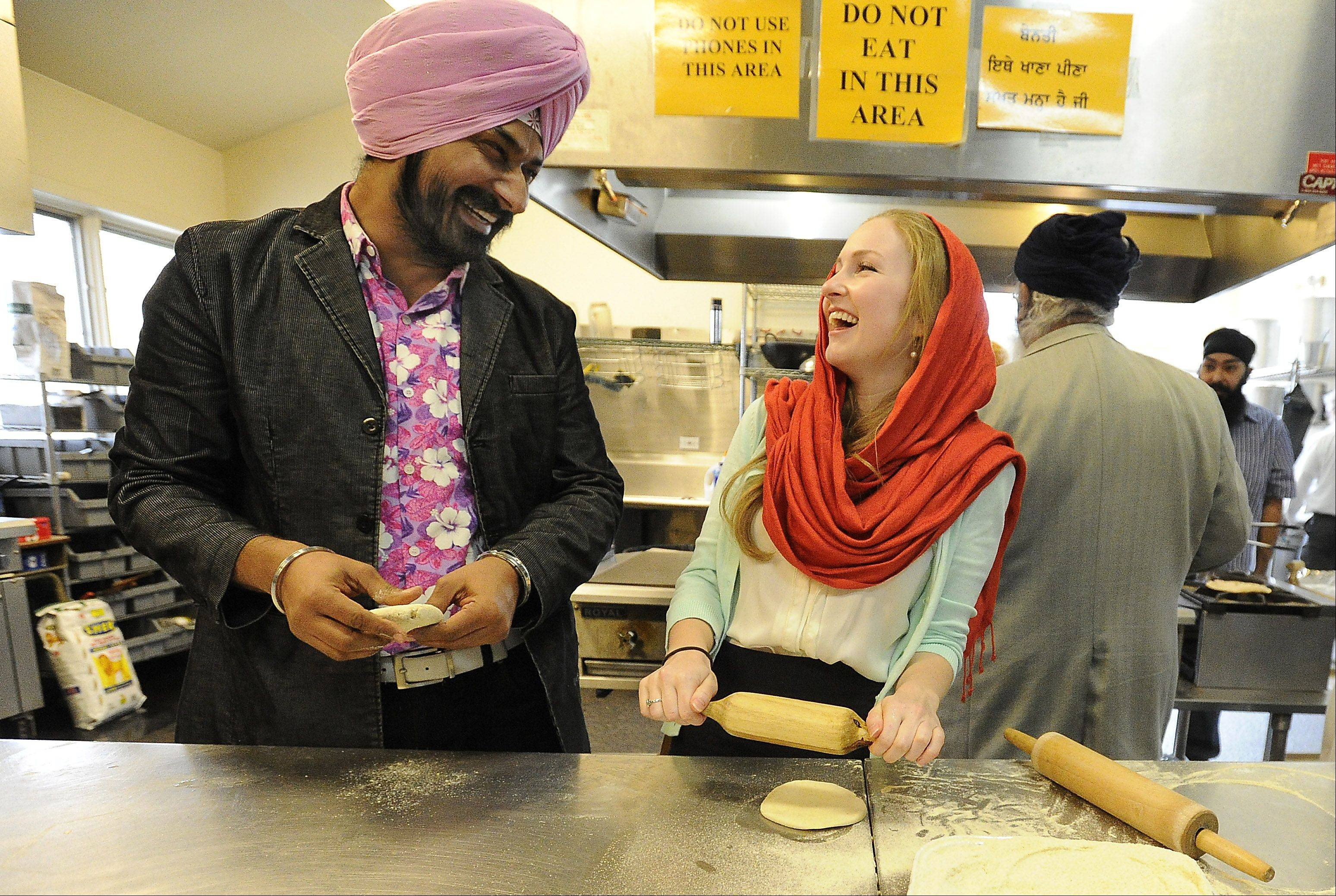 Indian TV/Bollywood film star Gurucharan Singh visits the Sikh Gurdwara Religious Society of Chicago in Palatine with her friend Kari Irwin, 25, making Chapati and having a good time.