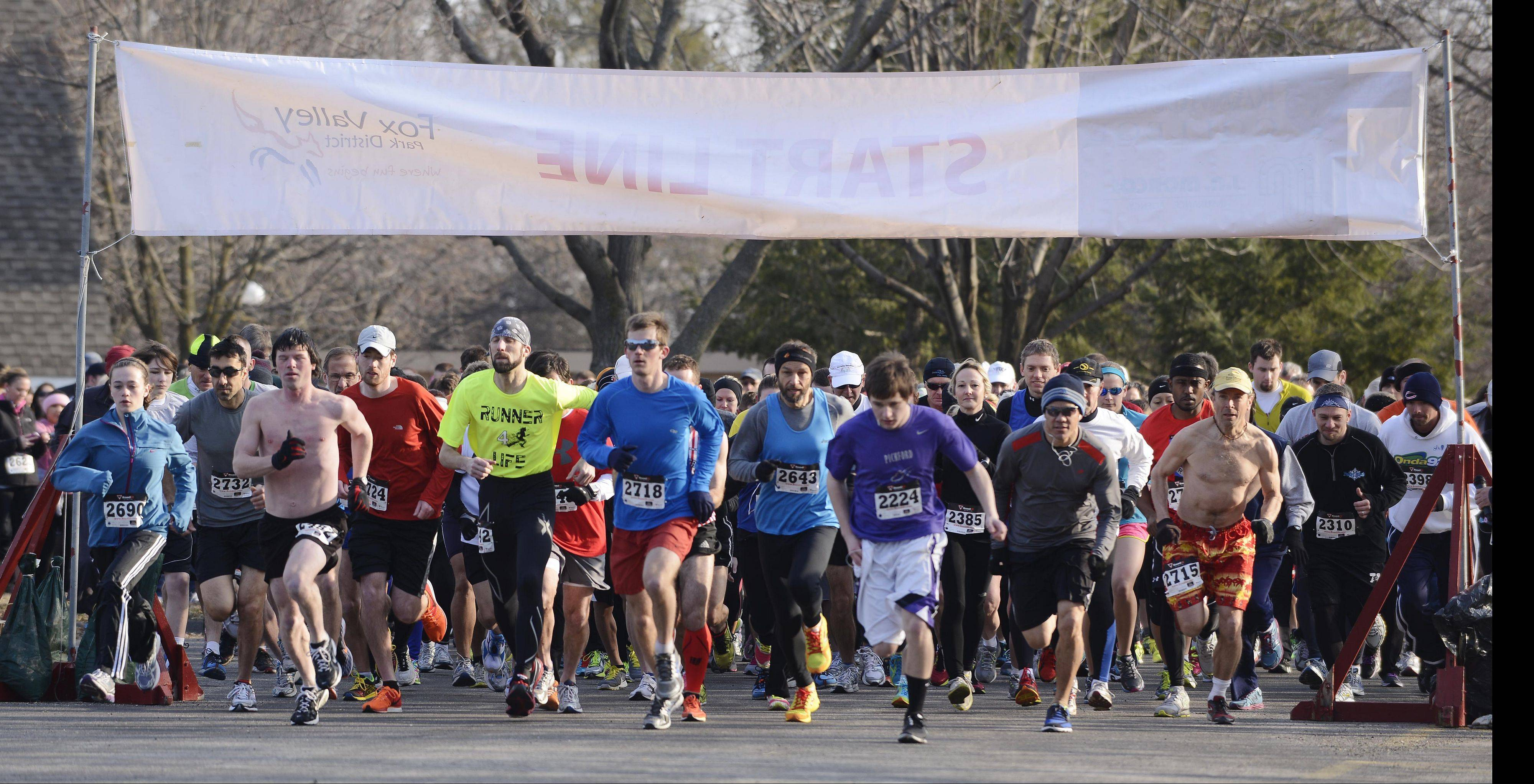 Runners depart from the starting line during the annual Spring Gallop 5K race at Blackberry Farm, Aurora.