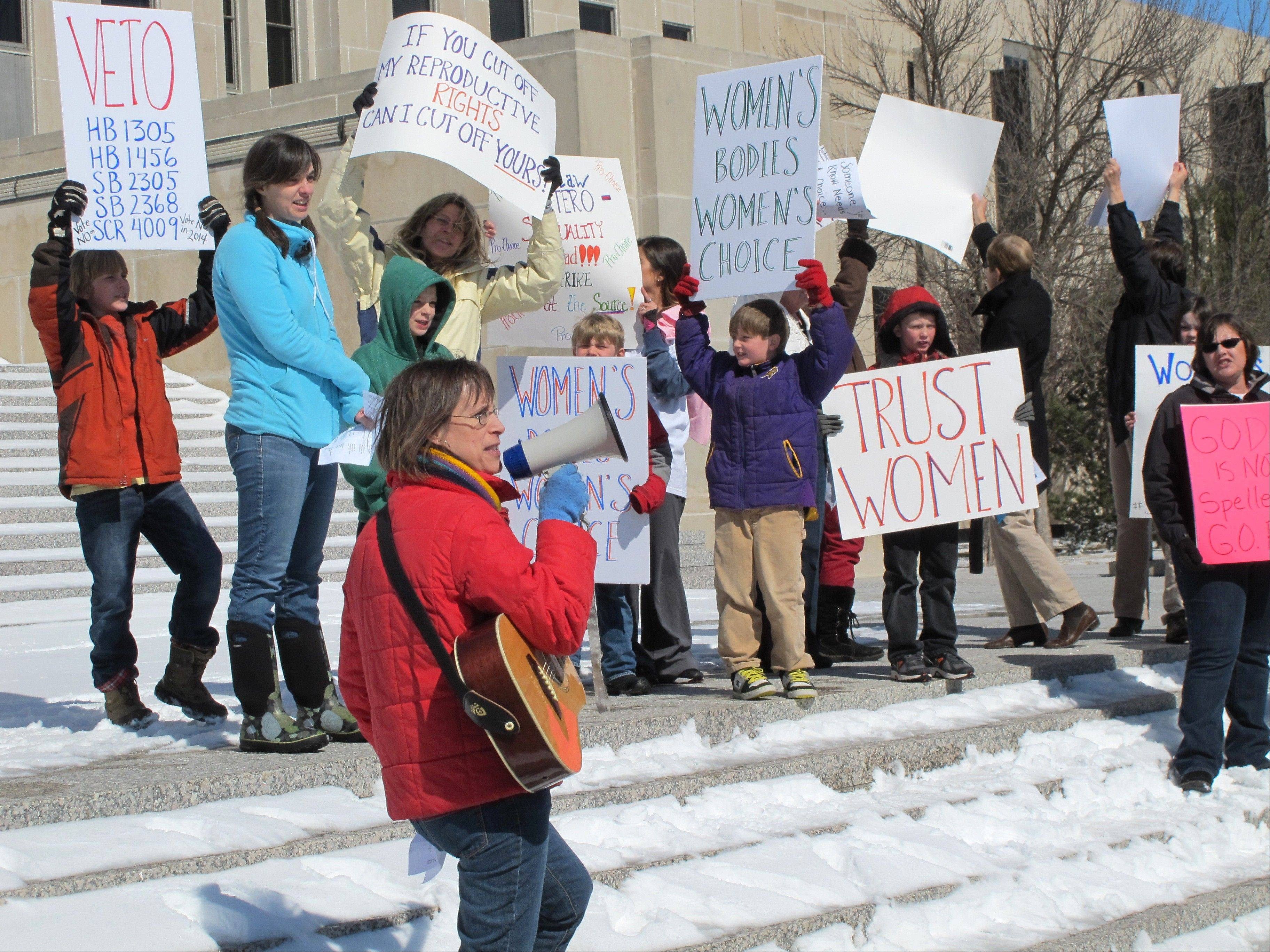 An abortion-rights rally is held at the state Capitol in Bismarck, N.D., on March 25. Rival legal teams, each well-financed and highly motivated, are girding for high-stakes court battles over the coming months on laws enacted in Arkansas and North Dakota that would impose the nation's toughest bans on abortion.