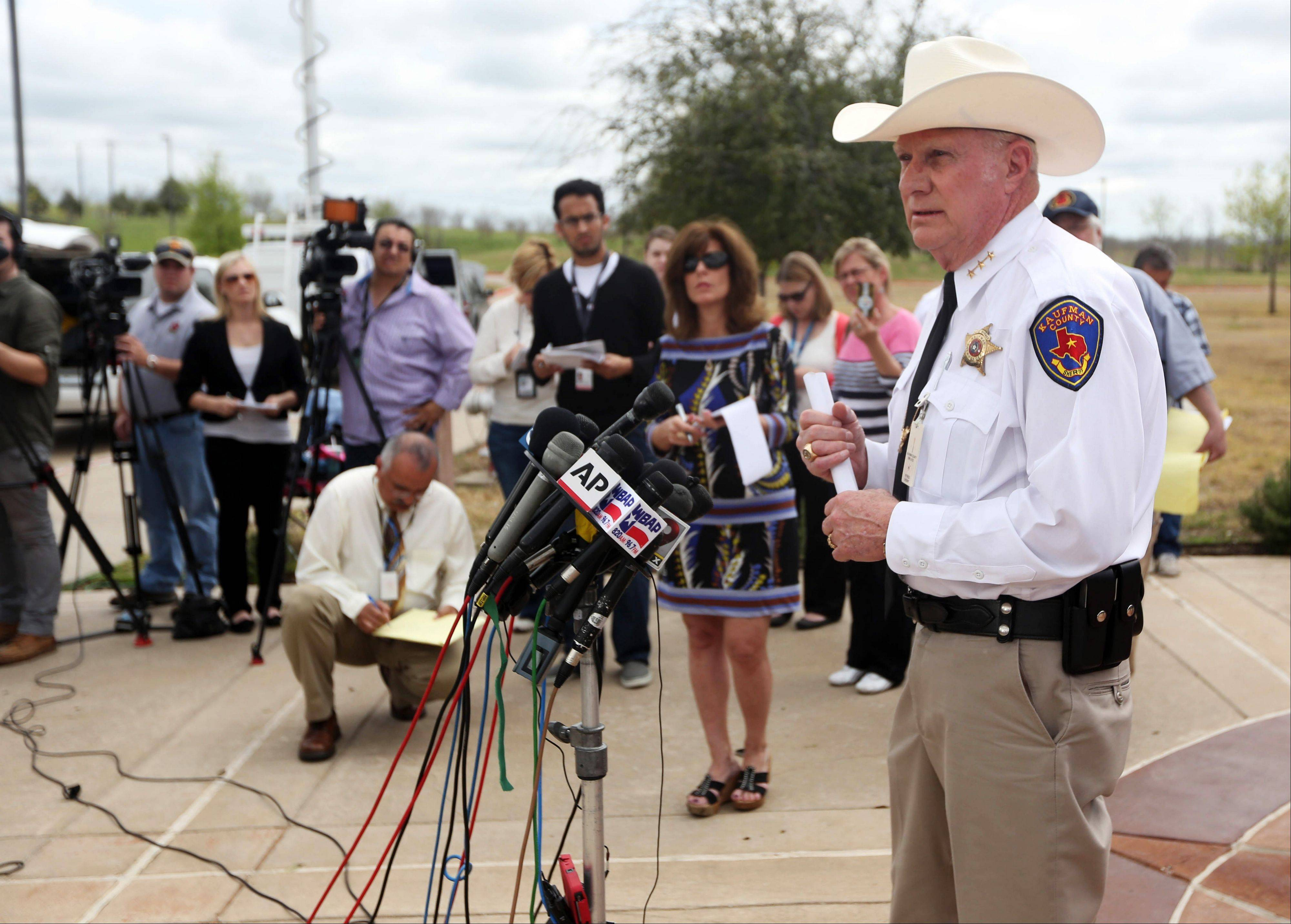 Kaufman County Sheriff David Byrnes, right, speaks at a news conference, Sunday in Kaufman, Texas. On Saturday, Kaufman County District Attorney Mike McLelland and his wife, Cynthia, were murdered in their home.
