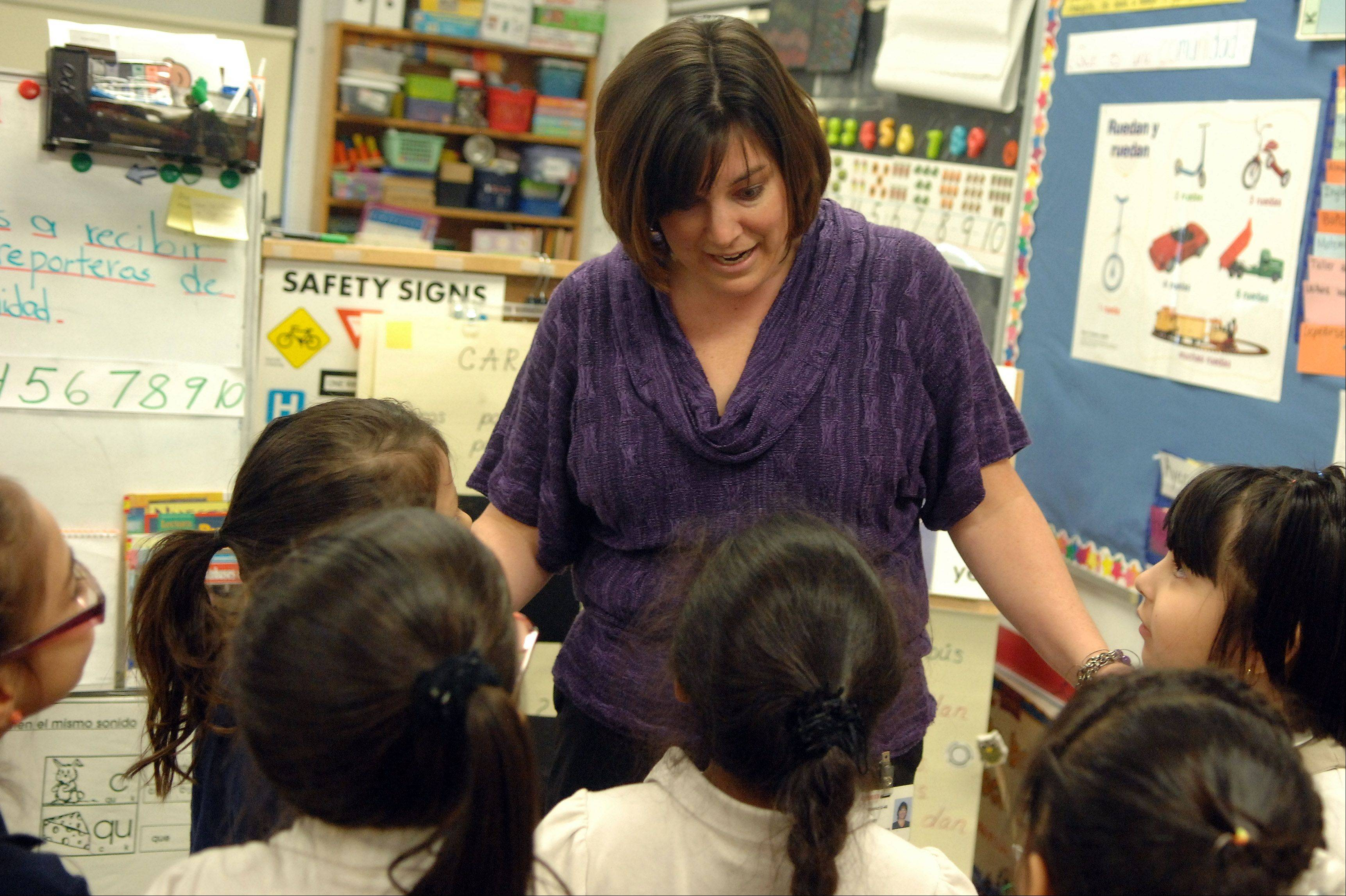 Garfield Elementary School kindergarten teacher Angie Gallegos gets ready to dismiss her class to lunch. Gallegos teaches in a dual language, full-day kindergarten program at Elgin Area School District U-46 and is one of 25 U-46 teachers involved in the pilot year for a new assessment of kindergartners.