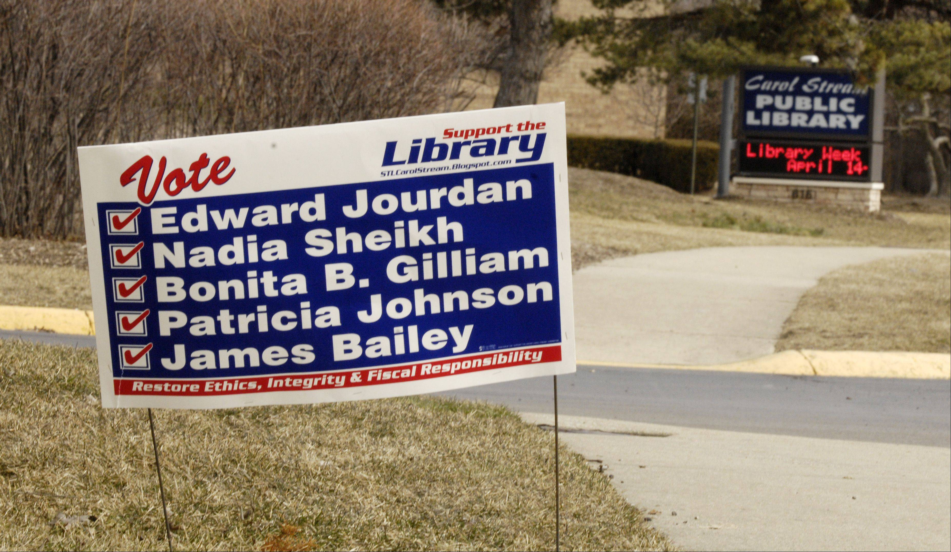 A home adjacent to the Carol Stream Public Library has posted a campaign sign for the Support the Library slate of candidates.