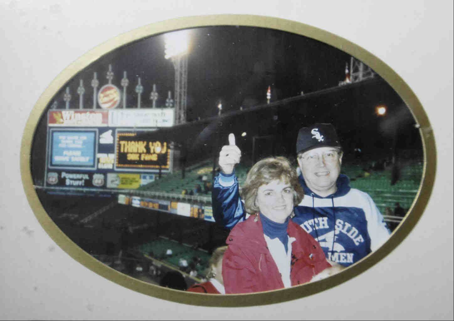 Frank Gambro poses with his wife, Joan, after the last game at the original Comiskey Field in 1990. The family photo hangs on a wall of his Elgin home.