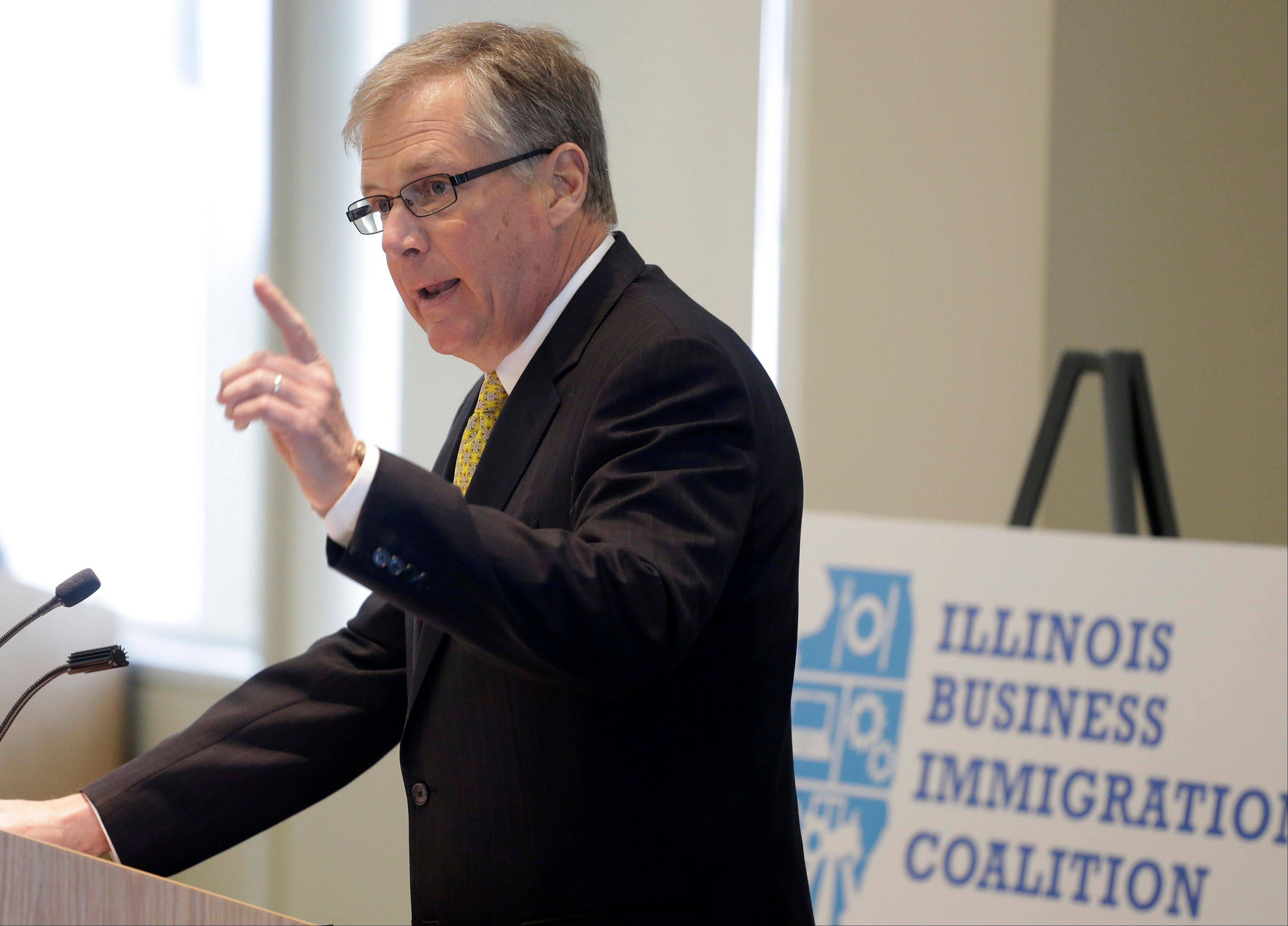 "Caterpillar CEO Doug Olberhelman speaks at an event of The Illinois Business Immigration Coalition Monday in Chicago. The new group of business leaders wants to recruit 300 CEOs and 1,000 small businesses in Illinois to push for ""common sense"" bipartisan immigration reform."