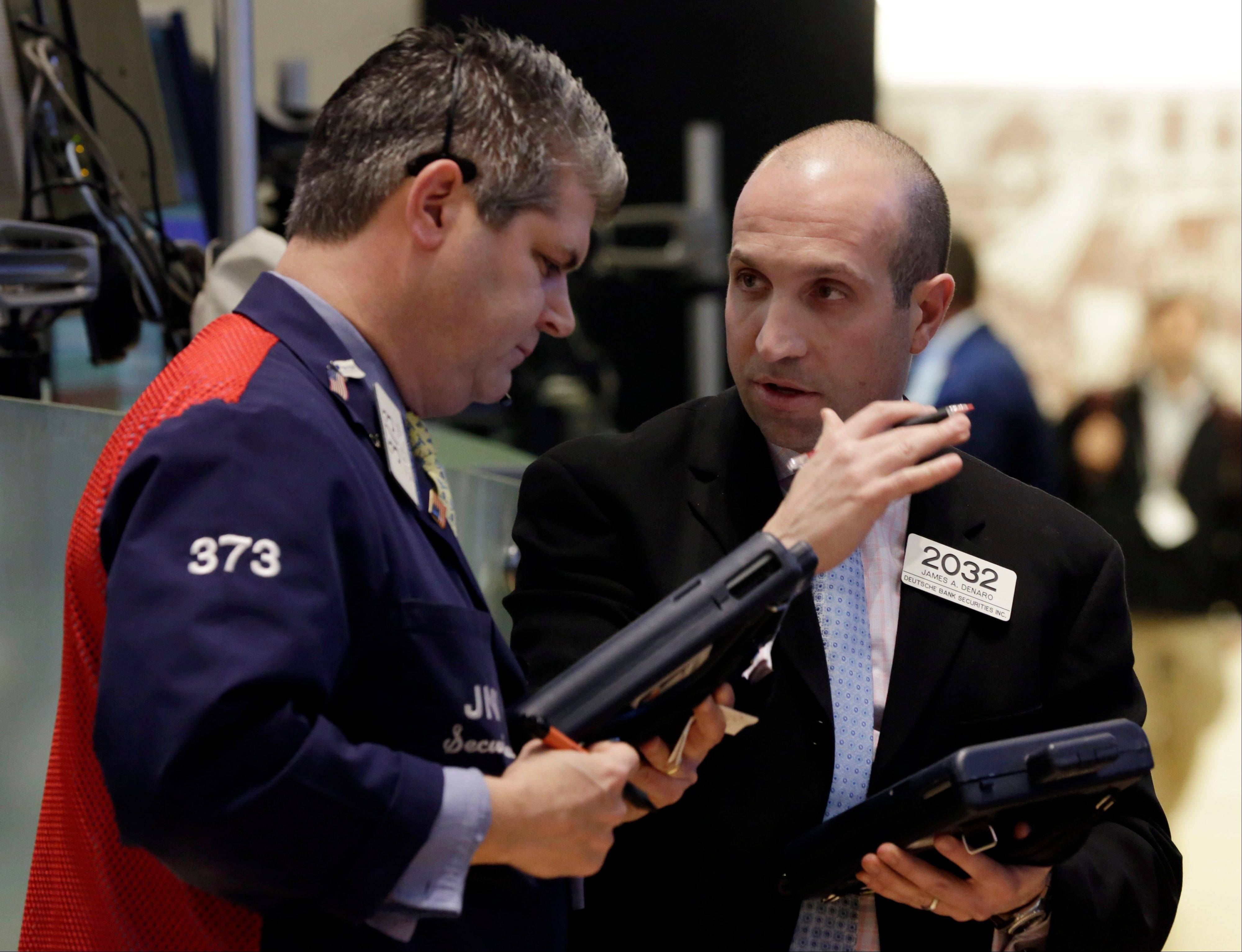 U.S. stocks fell, pulling the Standard & Poor's 500 Index lower after a record high, as a report showed American manufacturing expanded less than forecast in March as factories slowed production and orders waned.