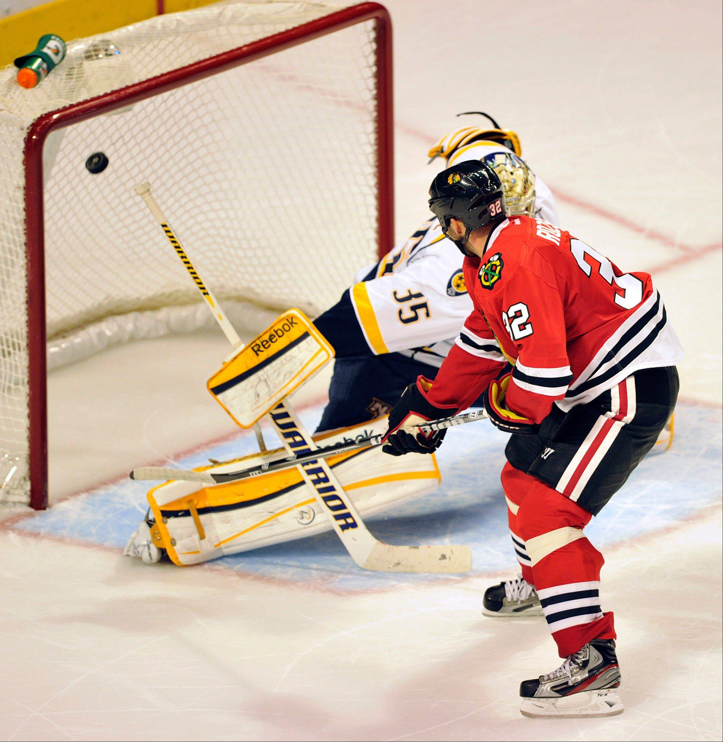 Blackhawks' Michal Rozsival scores the winning goal against Predators goalie Pekka Rinne during the shootout Monday night at the United Center. The Blackhawks defeated the Predators 3-2.
