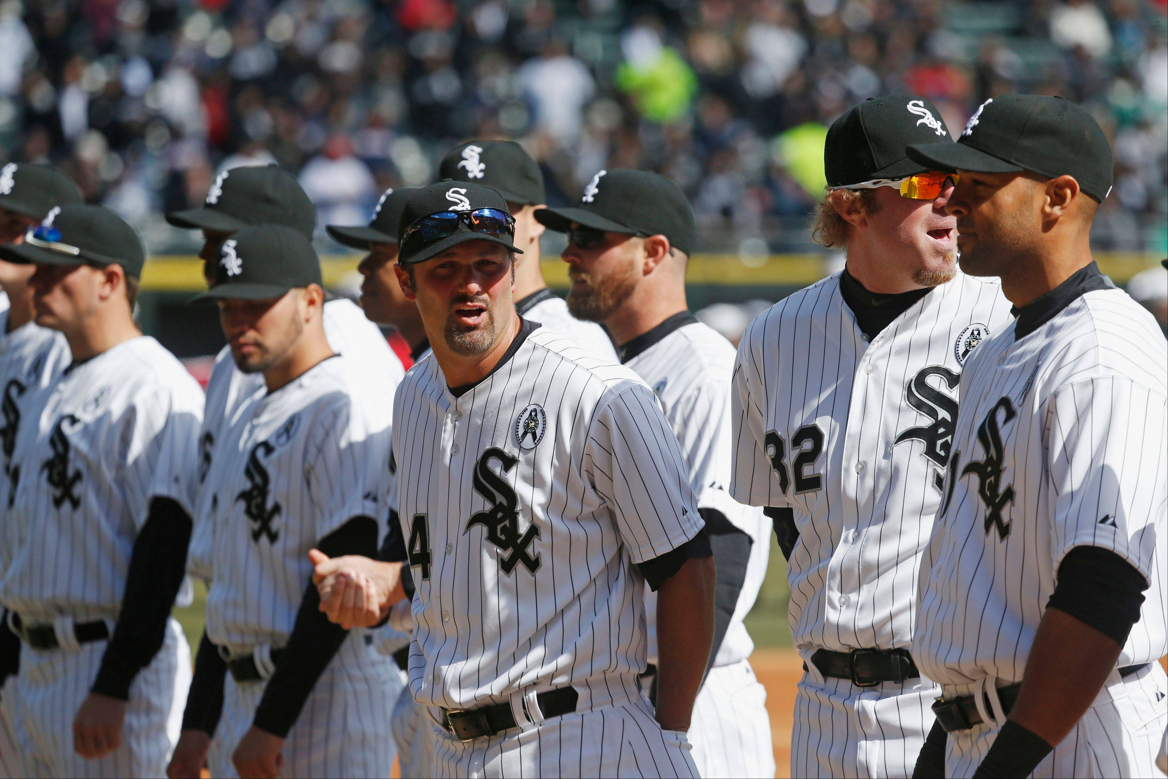 White Sox first baseman Paul Konerko, middle, steps forward after being introduced with teammates Monday before the White Sox' season opener against the Kansas City Royals at U.S. Cellular Field.