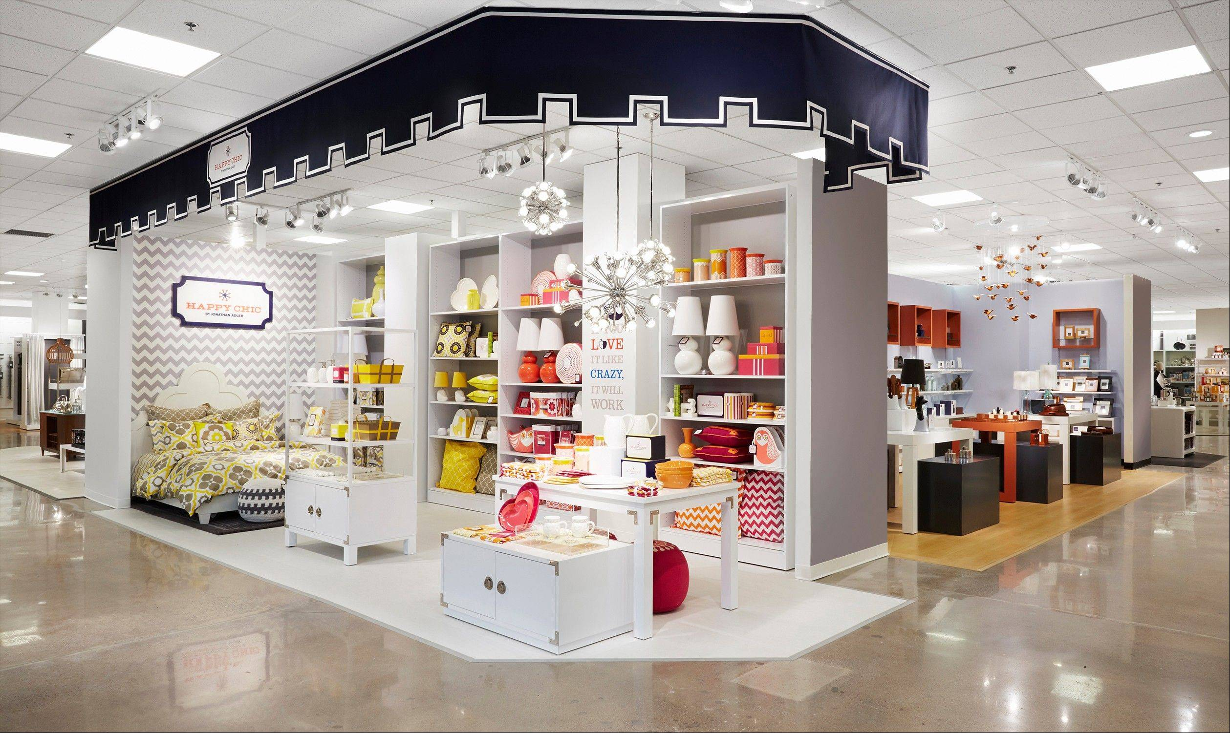 This undated image provided by J.C Penney shows a design for a new Jonathan Adler section in the home area of the department store. The struggling department store chain is set to unveil Friday an overhauled home area that will feature a string of shops filled with such items as bright blue geometric-patterned pillows, stylish stainless steel tea kettles and sleek oak coffee tables.