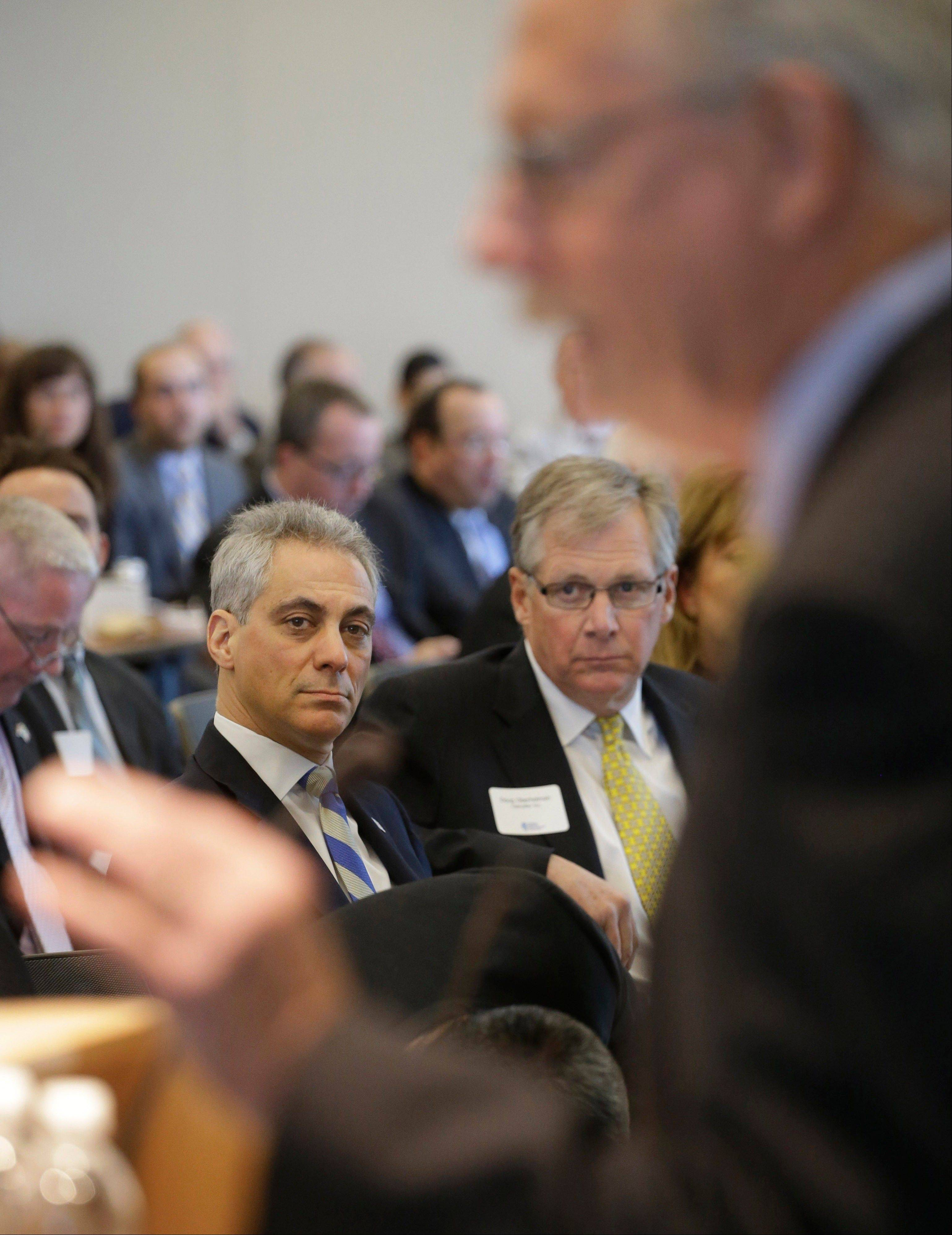 Chicago Mayor Rahm Emanuel, left, and Caterpillar CEO Doug Oberhelman, center, listen as Pat Magoon, CEO of Lurie Children's Hospital speaks at an event for The Illinois Business Immigration Coalition on Monday.