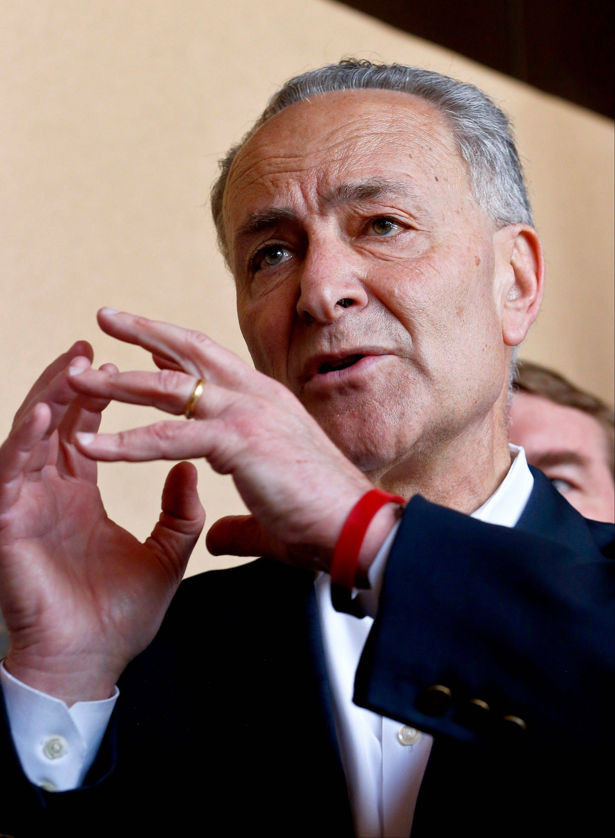 Sen. Chuck Schumer, D-N.Y., makes a point as he is joined by Sen. John McCain, R-Ariz., Sen. Jeff Flake, R-Ariz., and Sen. Michael Bennett, D-Colo., during a news conference after their tour of the Mexico border with the United States in Nogales, Ariz.