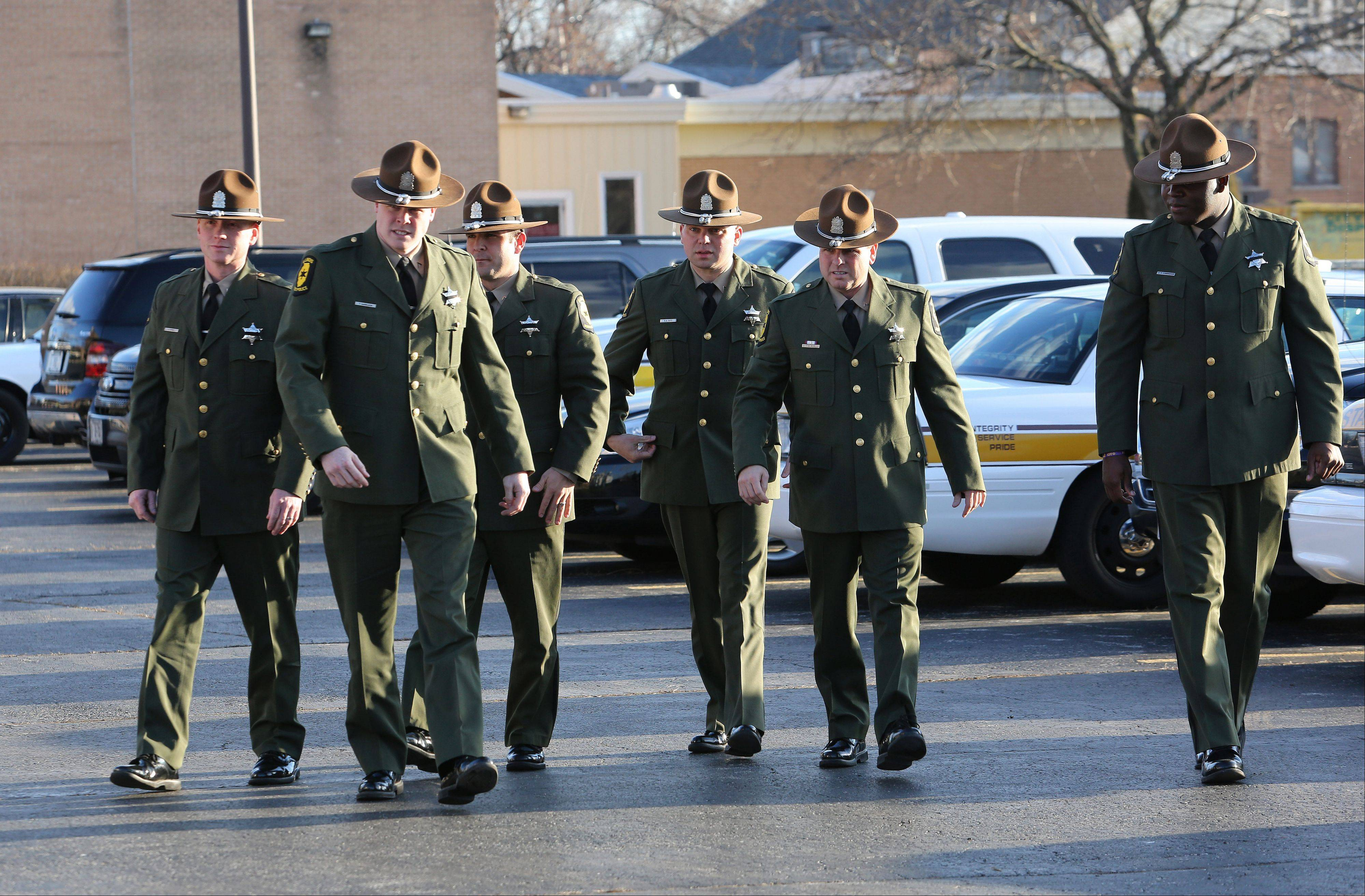 Illinois state troopers arrive for the visitation of James Sauter at Moraine Valley Church in Palos Heights on Monday. He was an Illinois state trooper from Vernon Hills, who was killed early Friday morning on the job.